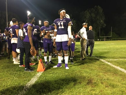 New Rochelle's Khairi Manns looks on during a 41-0 win over Scarsdale at Dean Field.