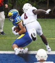 Delaware receiver Vinny Papale puts Delaware up by three touchdowns with an end zone catch on the sideline against Lafayette's Yasir Thomas in the second quarter at Delaware Stadium.