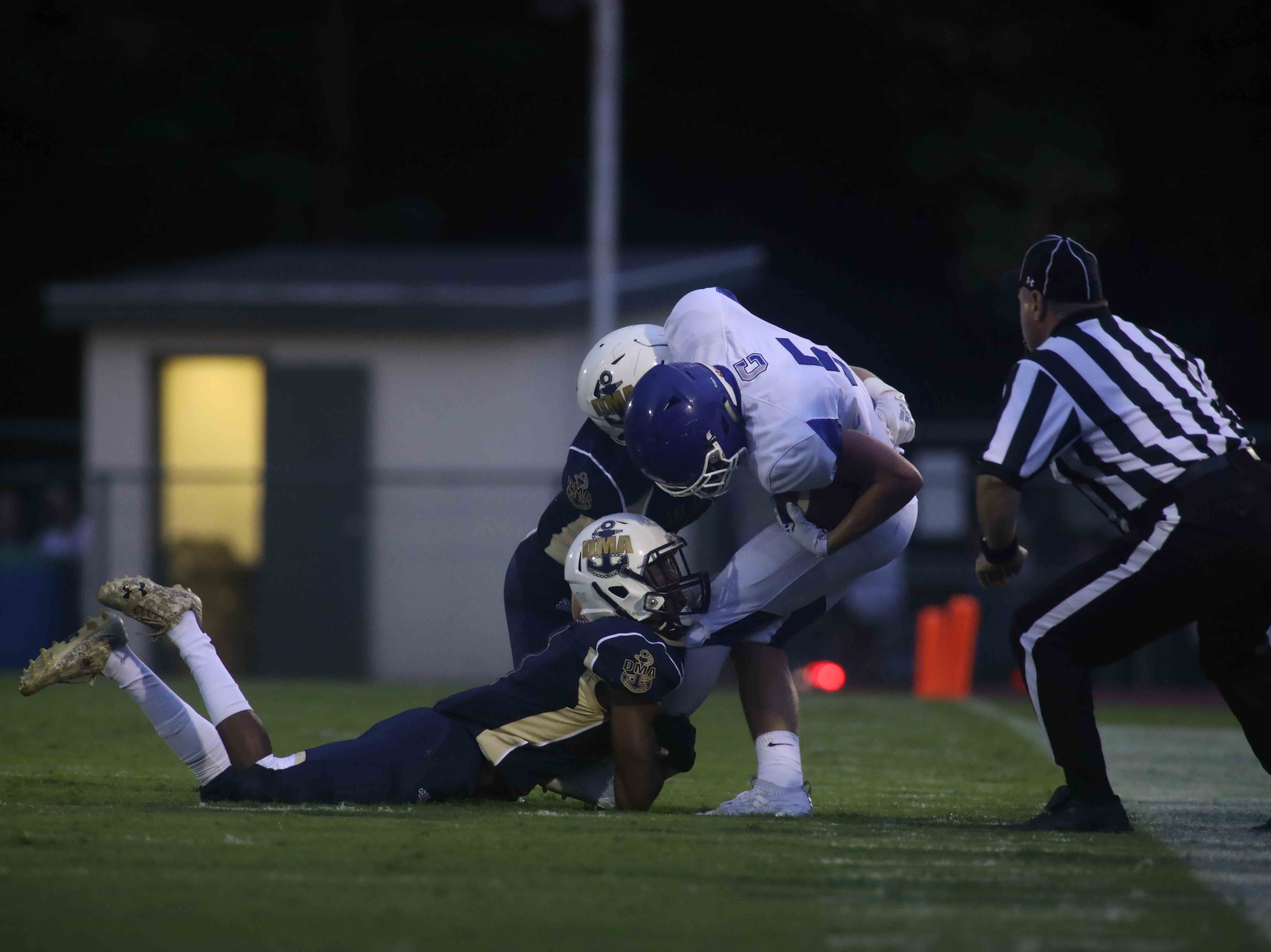 Delaware Military Academy running back Corahn Alleyne (1) tackles wide receiver Peter Gosser (5) in the first quarter of a week one DIAA game between Delaware Military Academy and Charter School of Wilmington, Friday, Sept. 07, 2018 at Baynard Stadium in Wilmington, DE.