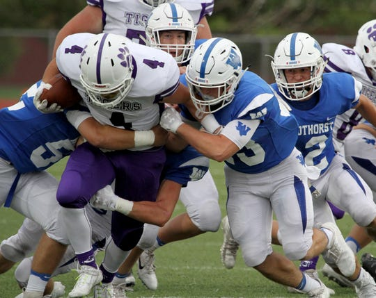 Jacksboro's Zane Hackley is tackled by a gang a Windthorst defenders Friday, Sept. 7,  2018, in Windthorst.
