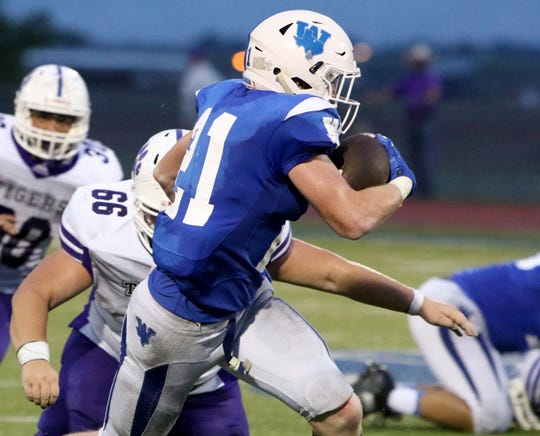 Windthorst's Awtry Blagg runs for several yards against Jacksboro Friday, Sept. 7,  2018, in Windthorst.