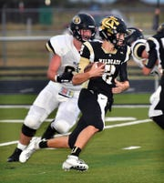 Archer City quarterback Carter Hilbers (2) had a hand in four touchdowns as the Wildcats took down Alvord, 38-18.