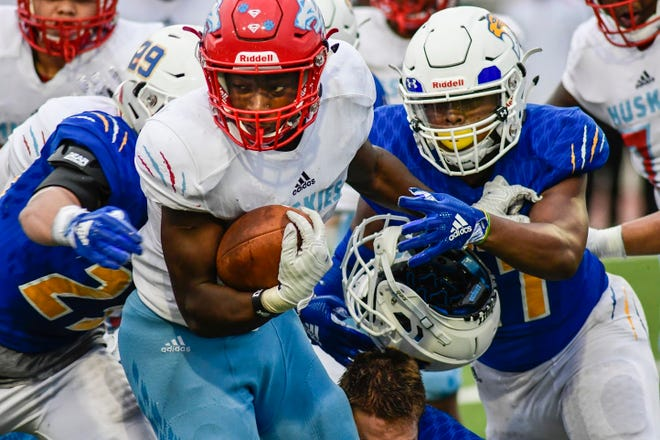 Frenship defenders swarm Hirschi's Daimarqua Foster (1) during a recent game.