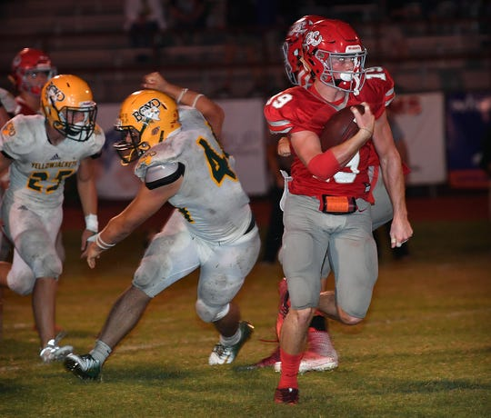 Holliday's Crue Jackson (19) breaks loose for a 65-yard touchdown run to start the second half of play against the Boyd Yellowjackets Friday night in Holliday.