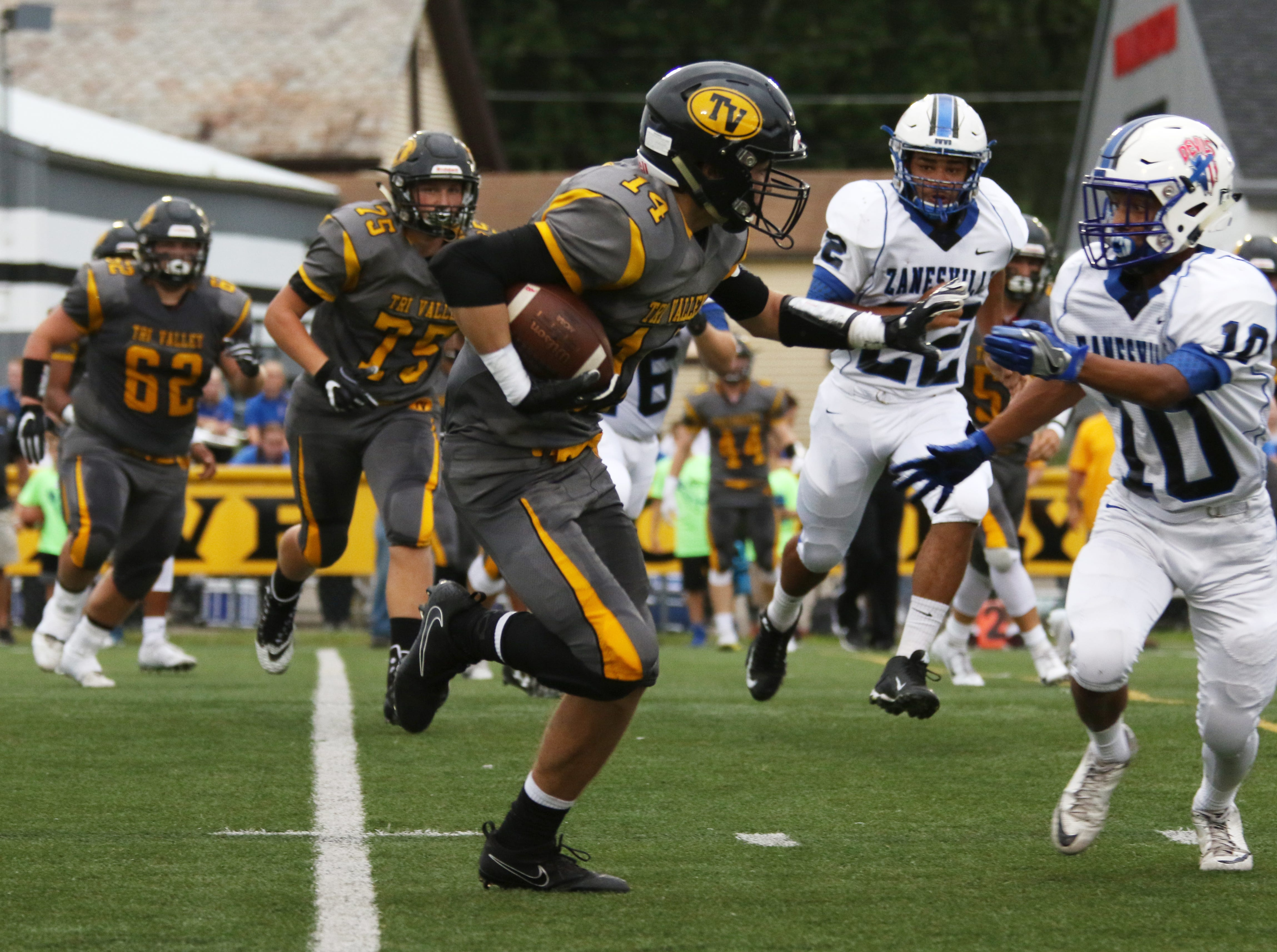 Tri-Valley's Keaton Williams carries the ball against Zanesville.