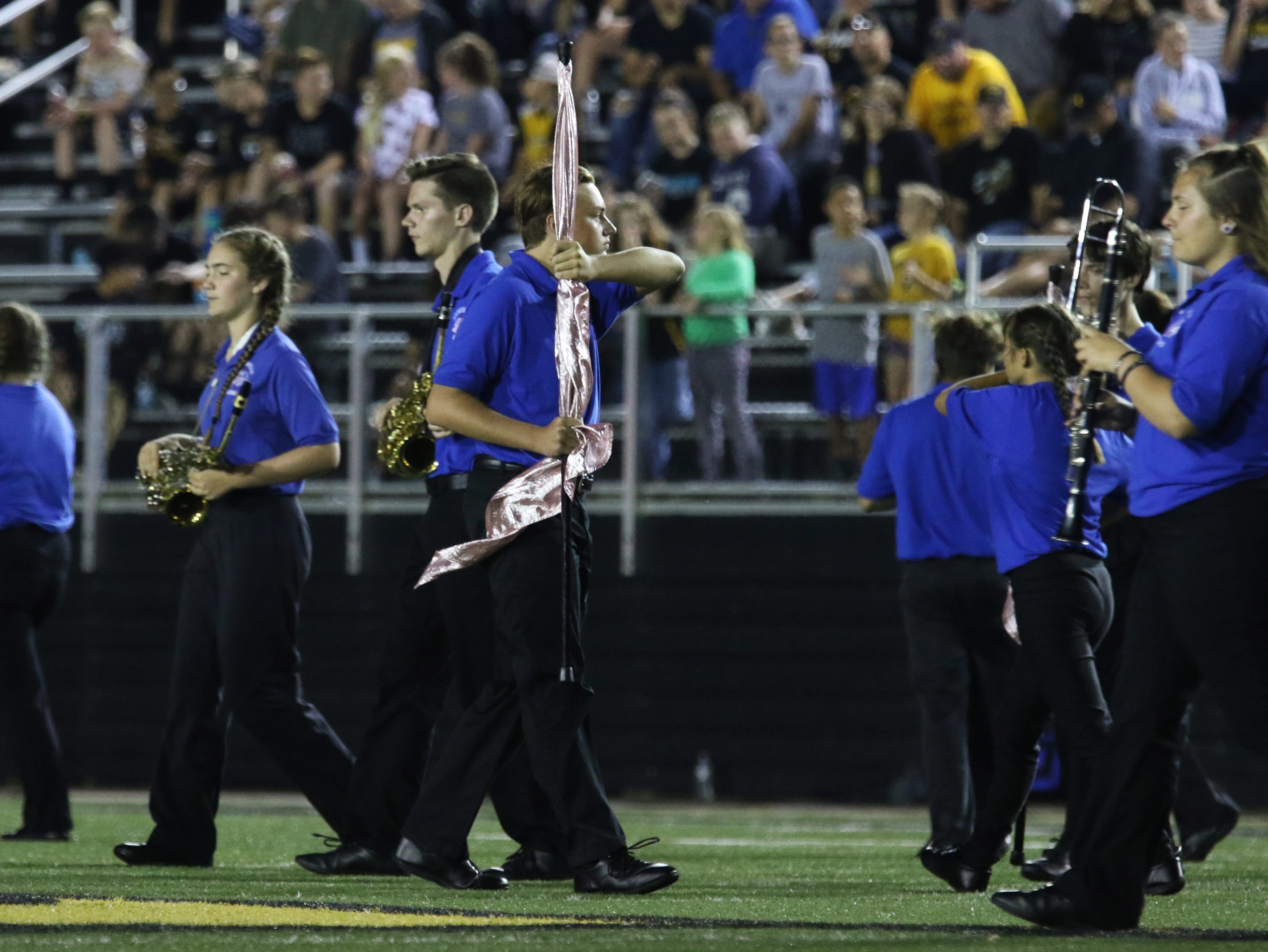 The Zanesville High School marching band performs during halftime of Friday's game.