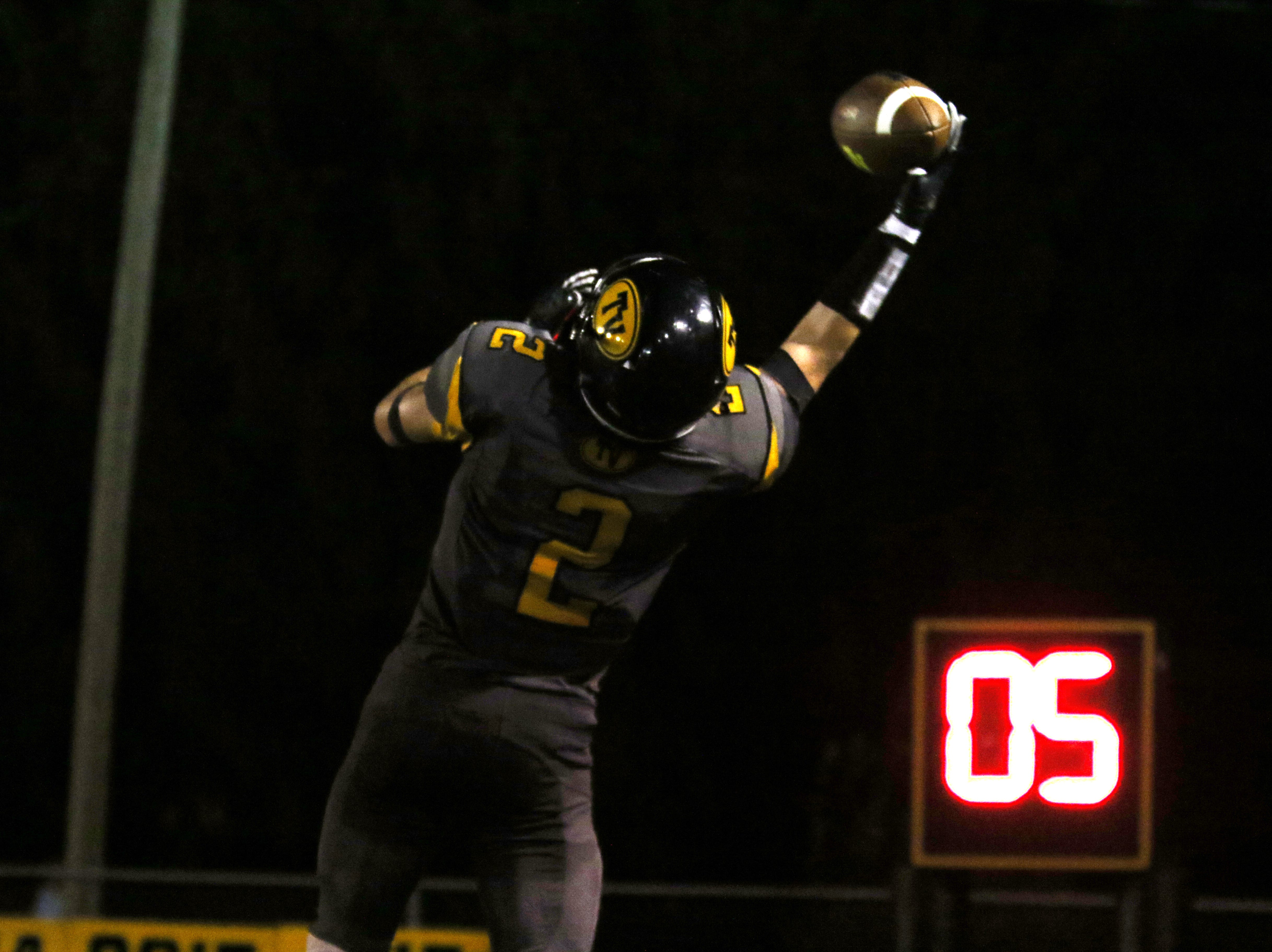 Tri-Valley's Blayze Taylor pulls in a pass against Zanesville.