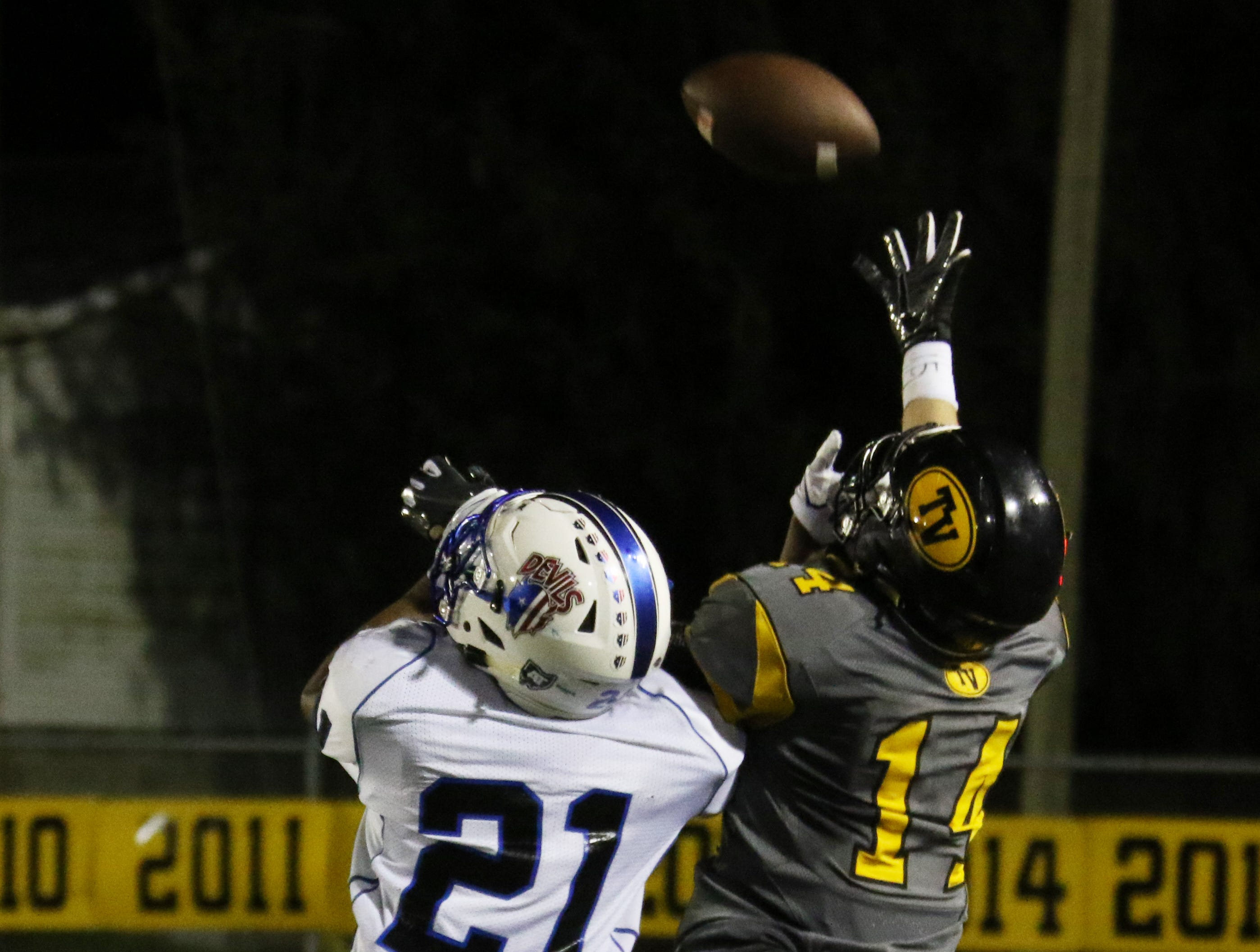 Zanesville's Julius Murphy defends a pass intended for Tri-Valley's Keaton Williams.