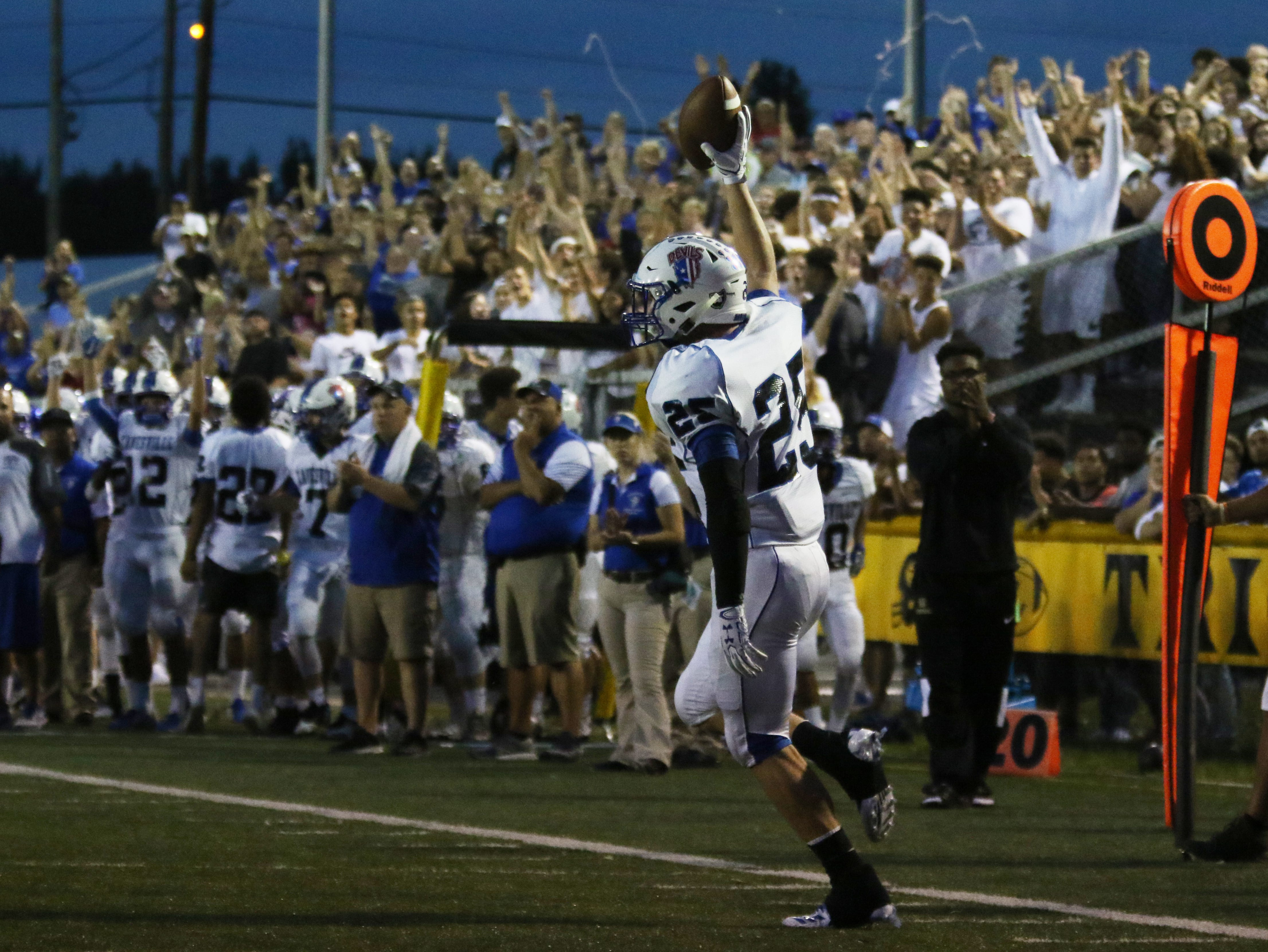 Zanesville's Dekker Davis celebrates after scoring against Tri-Valley.