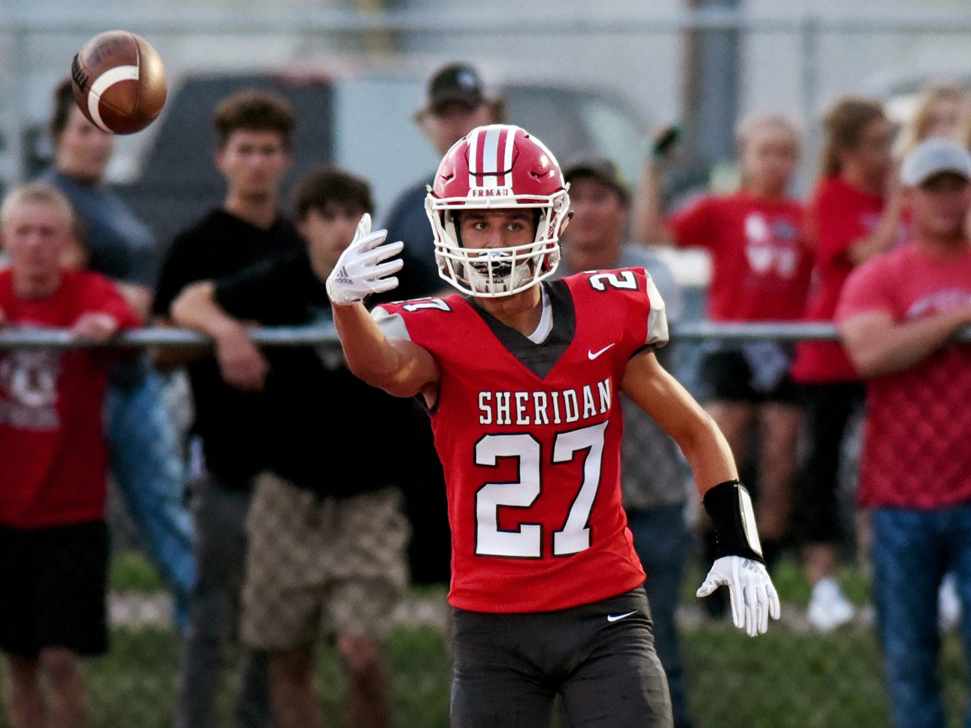 Sheridan's wide receiver Jacob Rhodes flips the ball to an official after catching a 30-yard touchdown pass in the game against John Glenn. This week the unbeaten Generals will start a tough three-game stretch by hosting Philo to headline the Muskingum Valley League slate.
