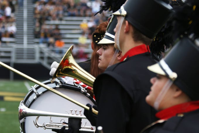 Tri-Valley High School's marching band gets ready to perform before the start of Friday's game against Zanesville.