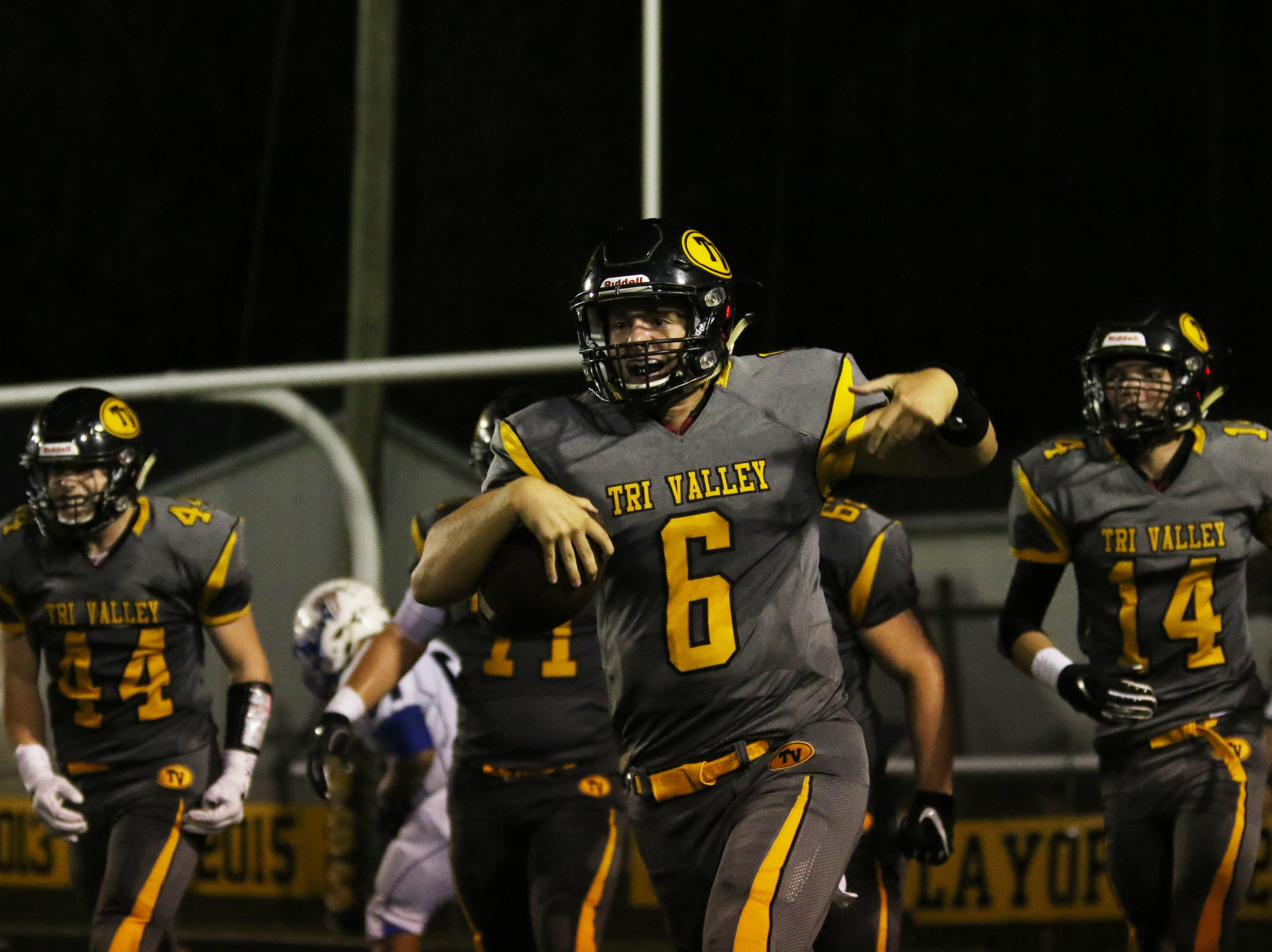 Tri-Valley's Luke Fargus celebrates a Tri-Valley touchdown against Zanesville.
