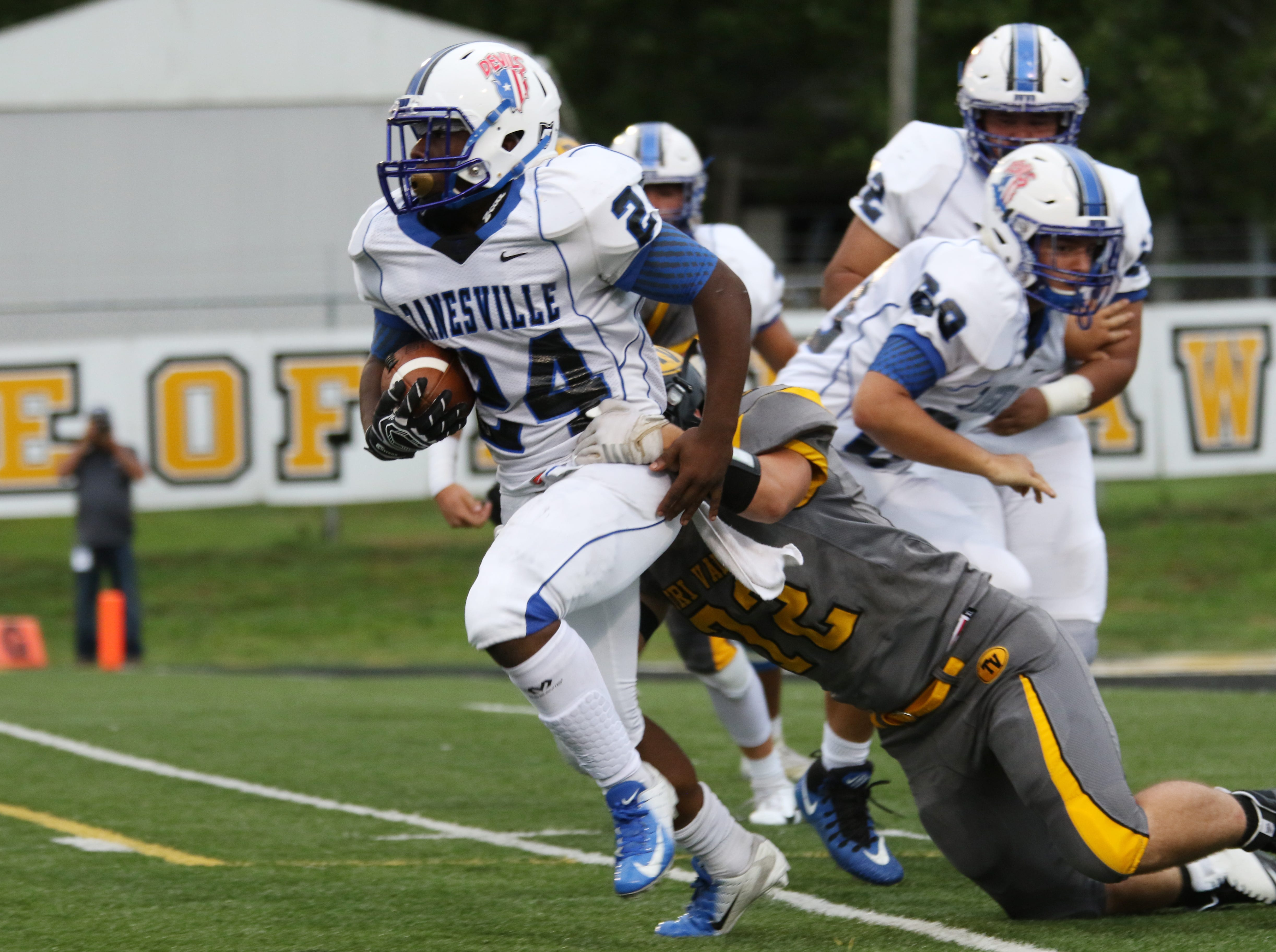 Zanesville's Jalen Haley carries the ball against Tri-Valley.