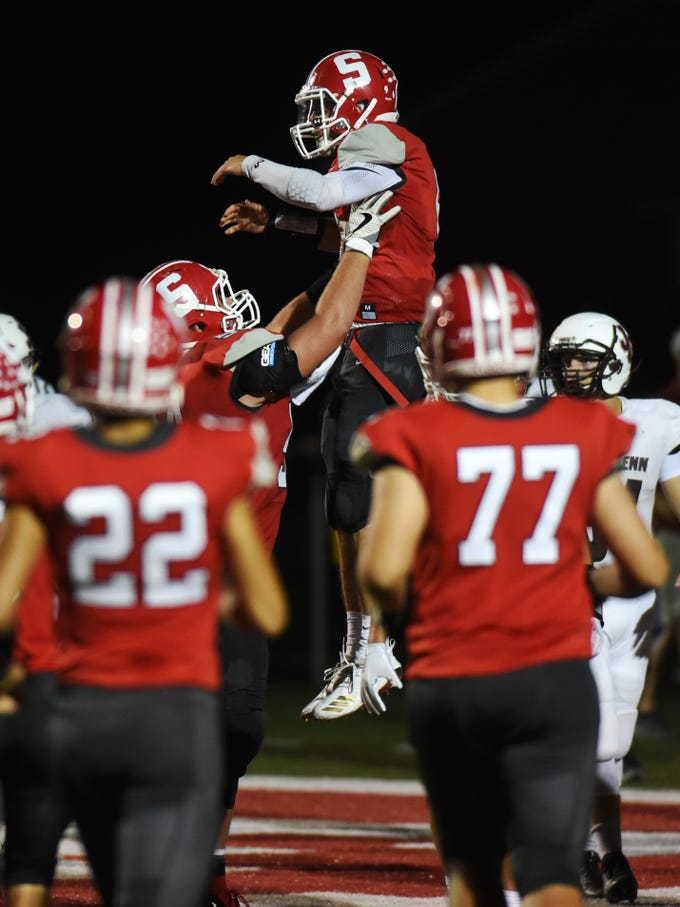 Sheridan's Collin Hill holds up quarterback Ethan Heller following the latter's 6-yard touchdown run in a 37-7 win against John Glenn at Paul Culver Jr. Stadium. The fifth-ranked Generals are outscoring the opposition by 38 points per game.