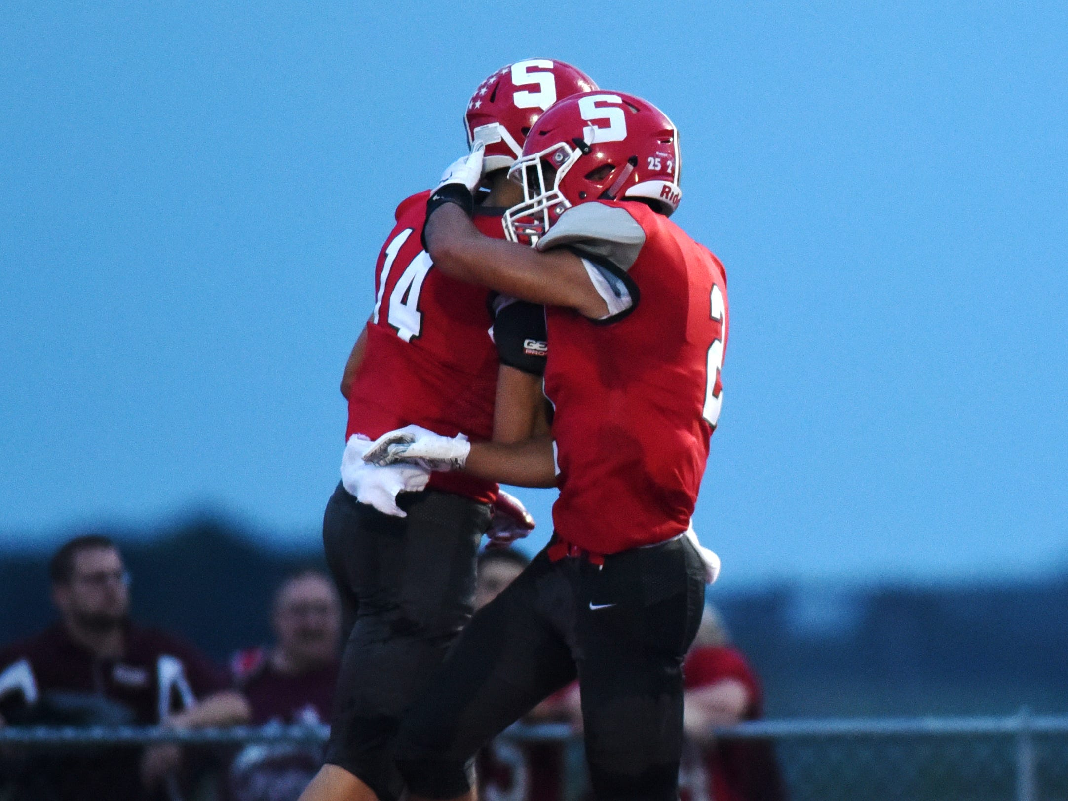 Logan Ranft, left, and Cole Casto celebrate in the end zone after Ranft caught a 51-yard touchdown pass in the second quarter of the Generals' 37-7 win against John Glenn on Friday night at Paul Culver Jr. Stadium.