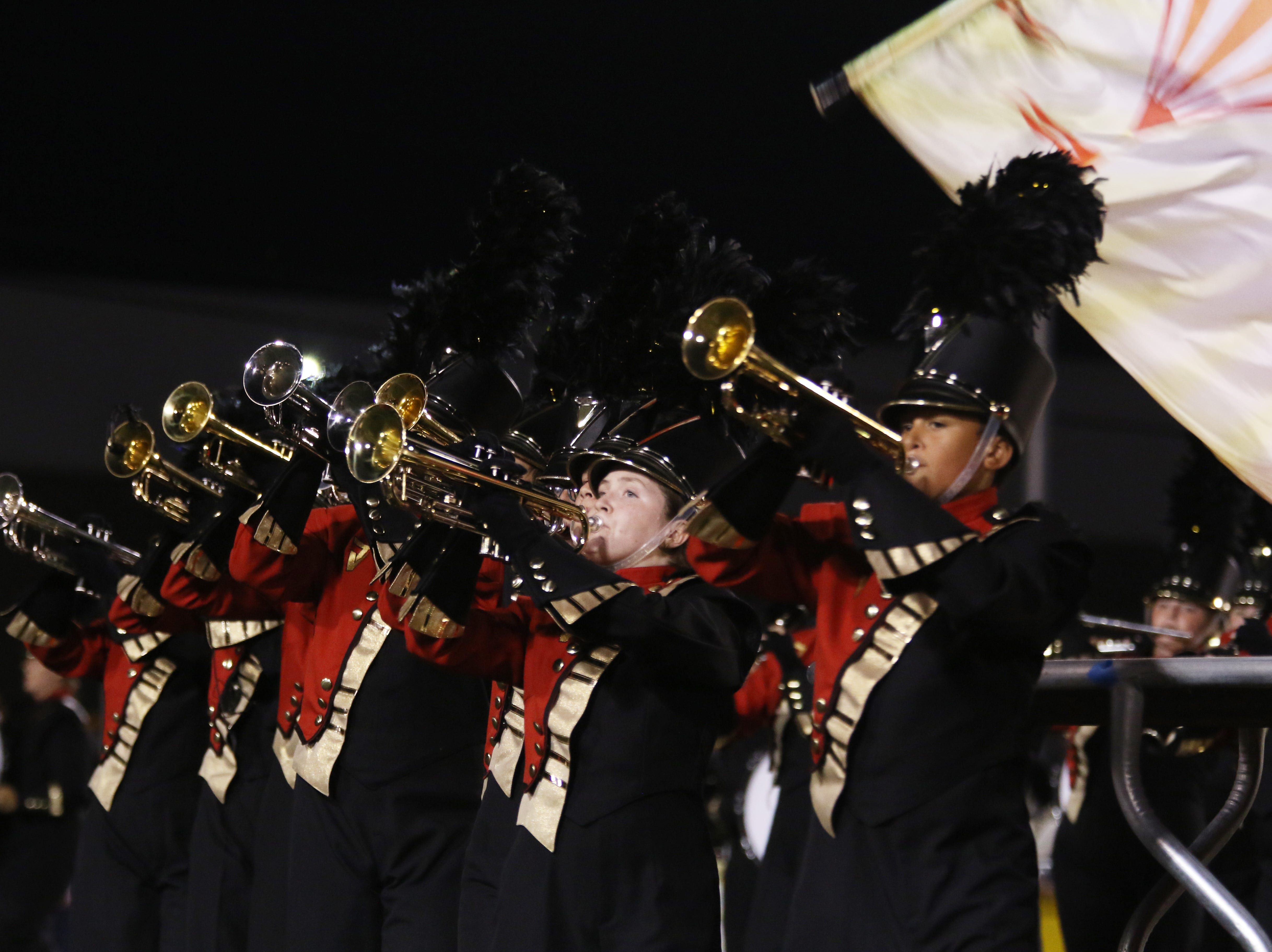 The Tri-Valley High School marching band performs during halftime on Friday.