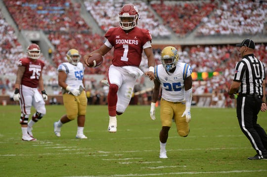 Oklahoma quarterback Kyler Murray skips into the end zone for a touchdown in the second quarter against UCLA.