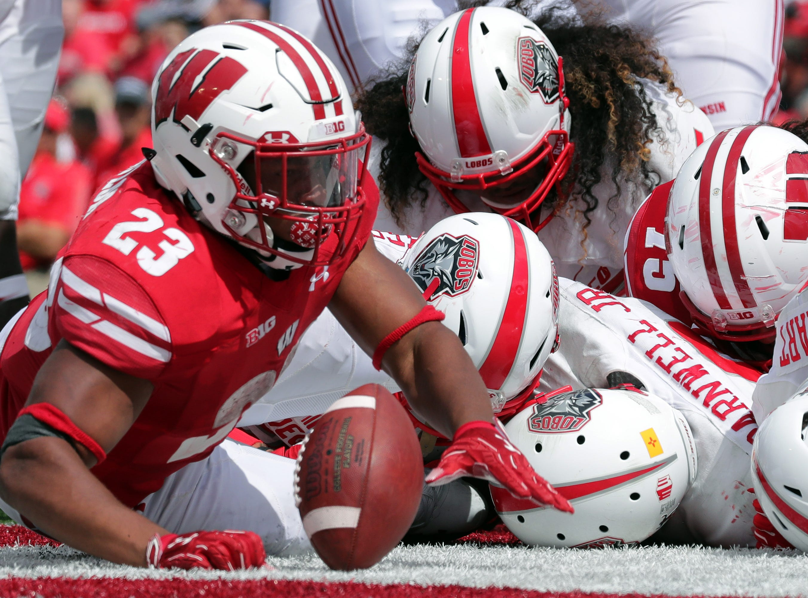Wisconsin running back Jonathan Taylor (23) breaks his way into the end zone to score a touchdown on a 1-yard run during the fourth quarter at Camp Randall Stadium.