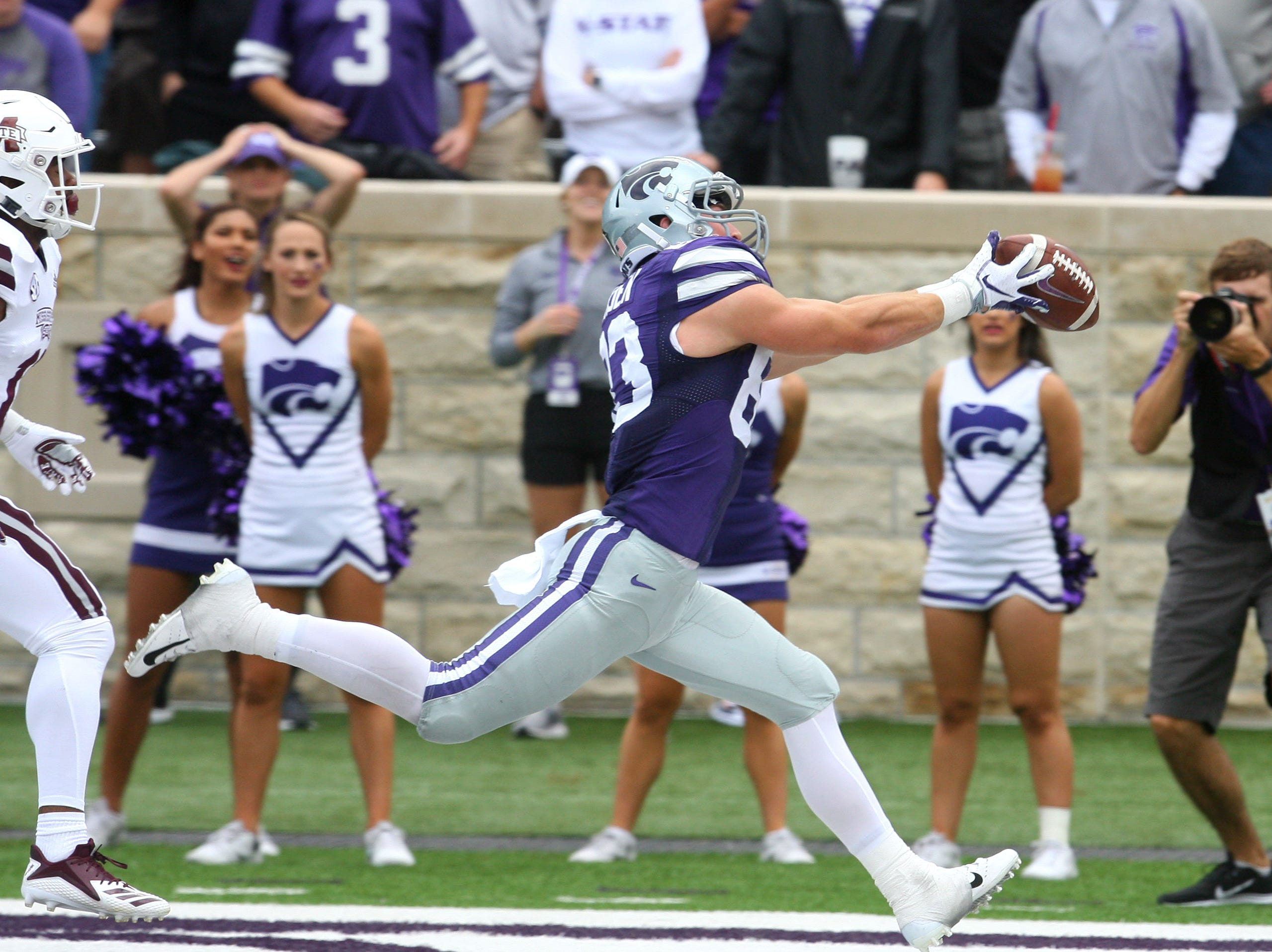 Kansas State Wildcats wide receiver Dalton Schoen (83) makes a touchdown catch against Mississippi State Bulldogs safety Jaquarius Landrews (11) during the third quarter at Bill Snyder Family Stadium.