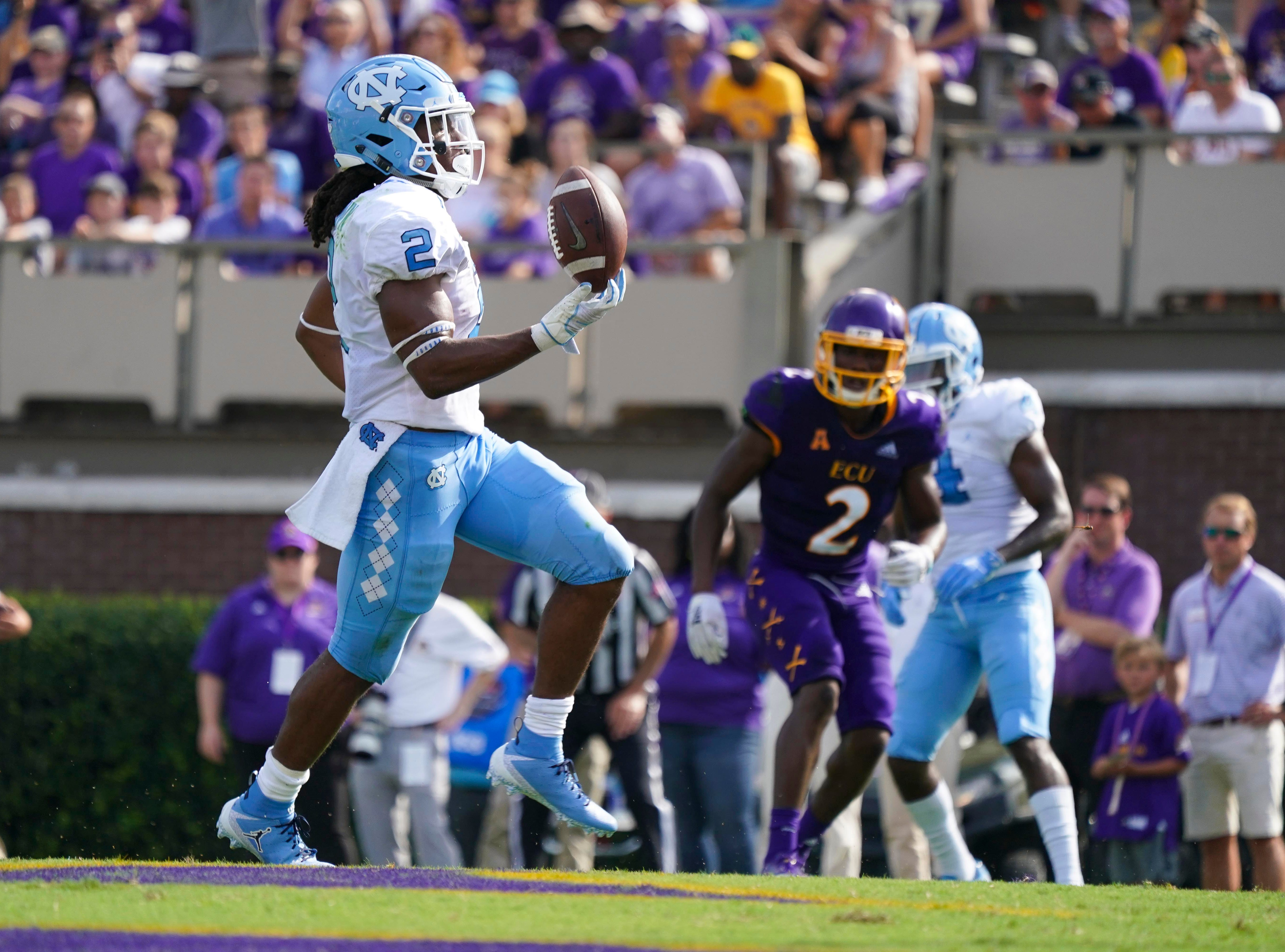 North Carolina Tar Heels running back Jordon Brown (2) celebrates after scoring a first-half touchdown against the East Carolina Pirates at Dowdy-Ficklen Stadium.