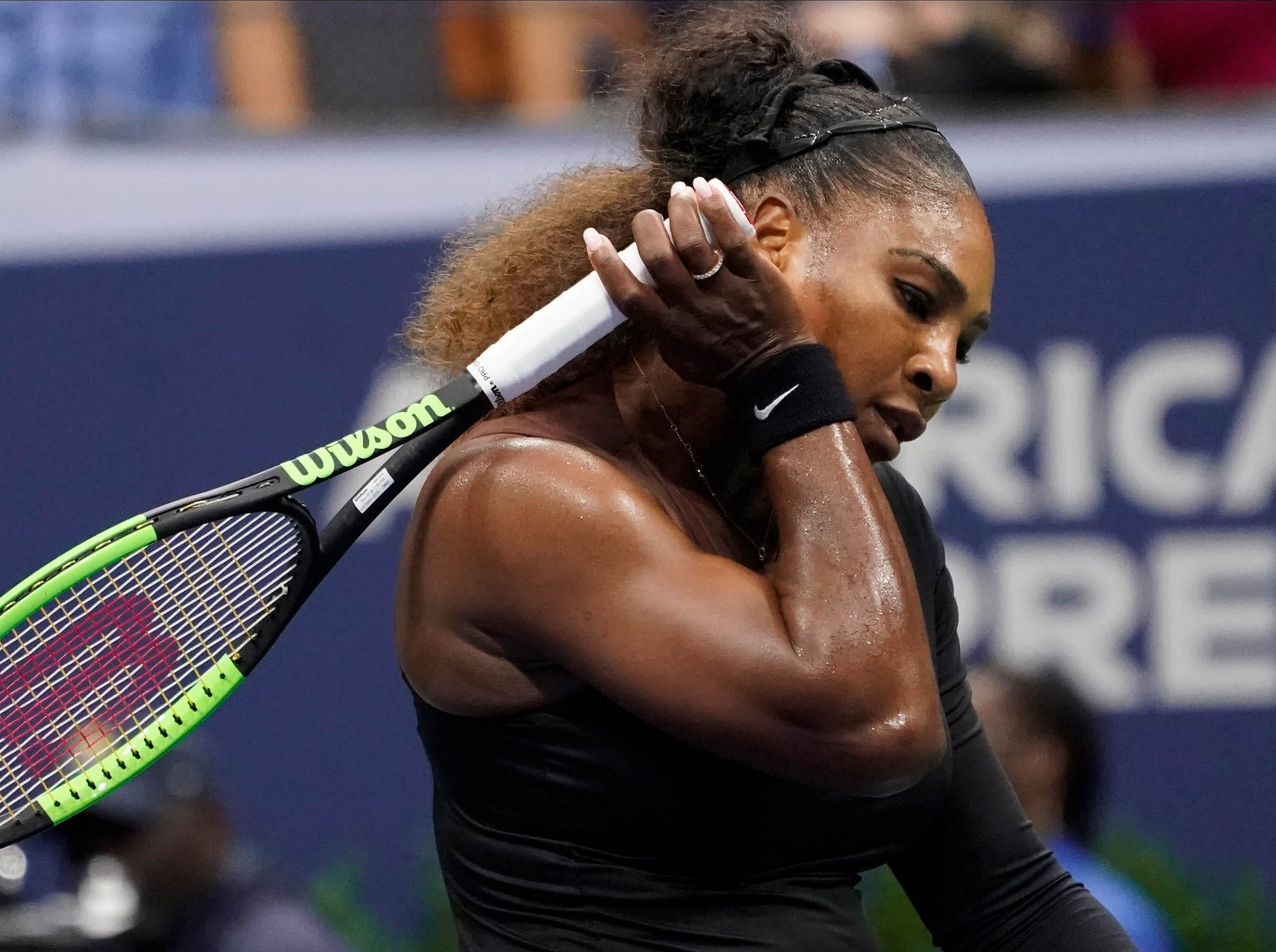 Serena Williams reacts after losing the first set to Naomi Osaka.