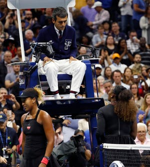 Serena Williams, right, talks with chair umpire Carlos Ramos after being defeated by Naomi Osaka, of Japan, in the women's final of the U.S. Open tennis tournament.