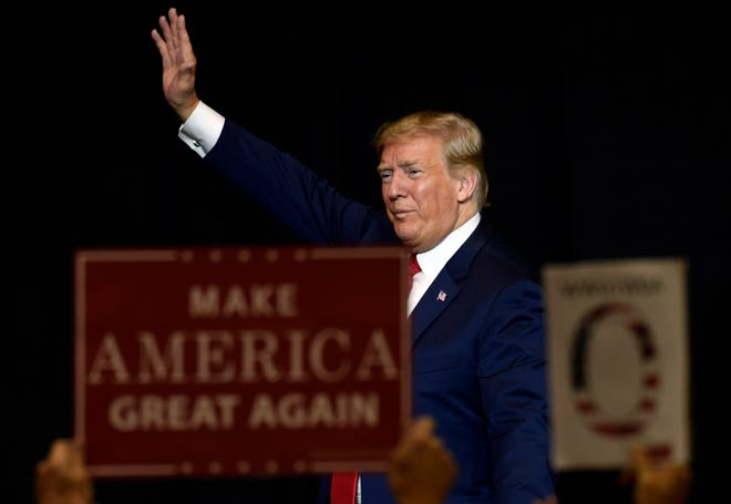 President Donald Trump walks off of the stage following a fundraiser in Sioux Falls, S.D., Friday, Sept. 7, 2018.