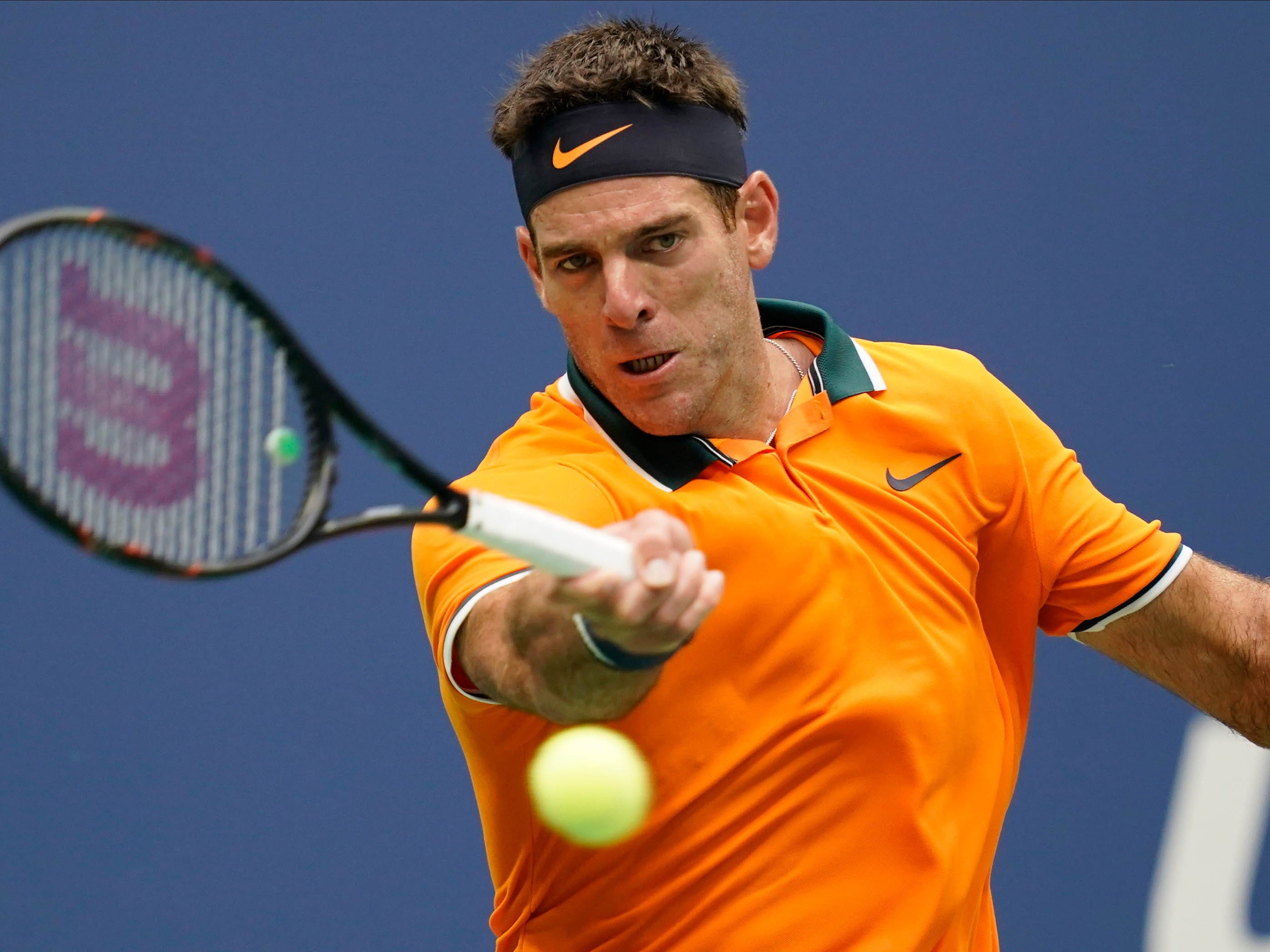 Juan Martin del Potro of Argentina hits to Rafael Nadal of Spain in the semifinal.