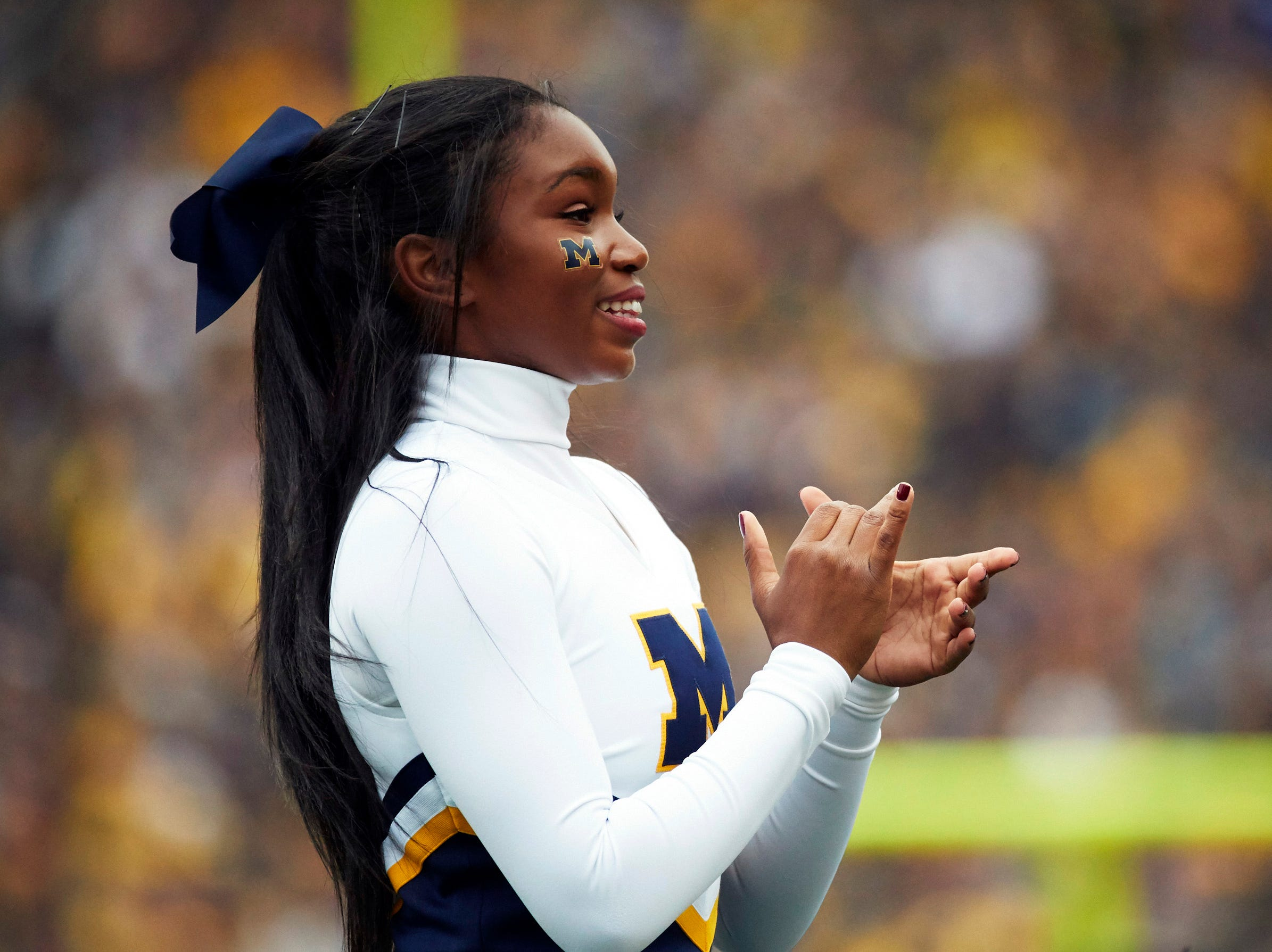 Week 2: A Michigan Wolverines cheerleader on the sideline in the first half against the Western Michigan Broncos.