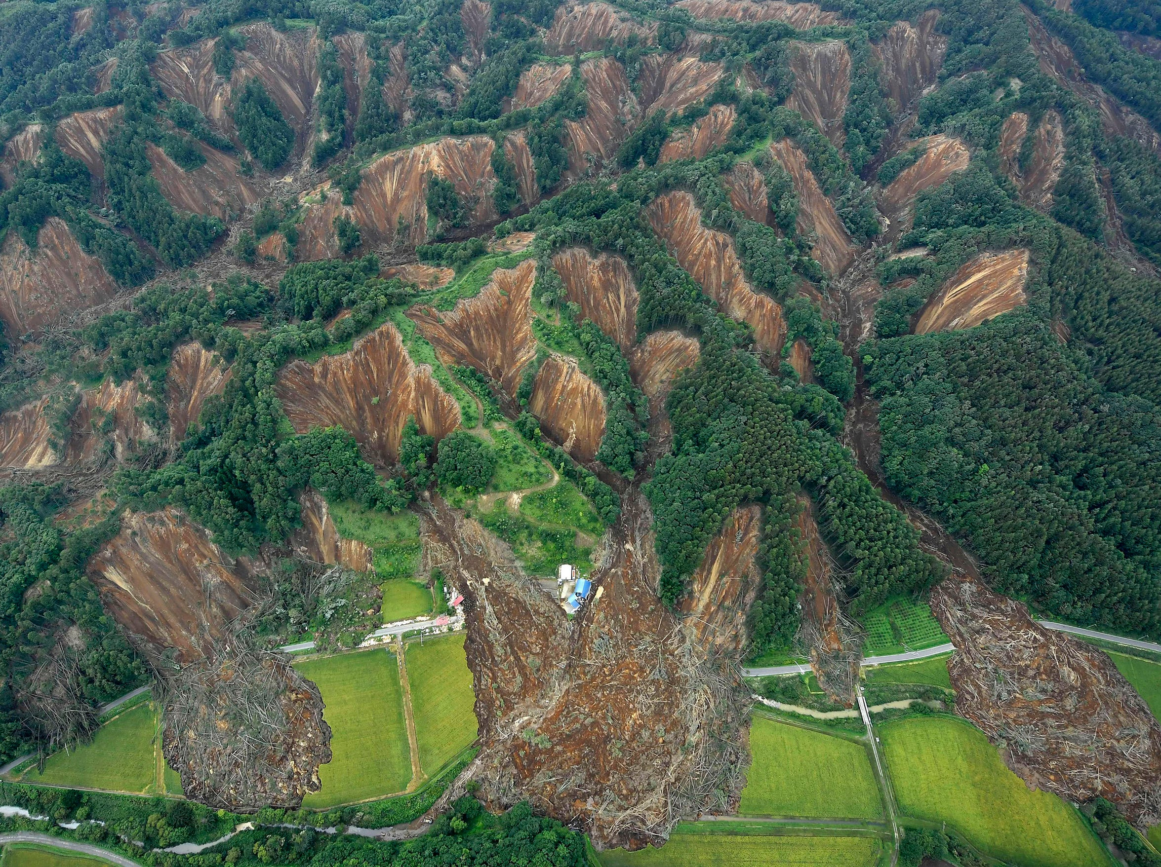 Landslides are seen after Thursday's earthquake in Atsuma, Hokkaido, northern Japan Saturday.