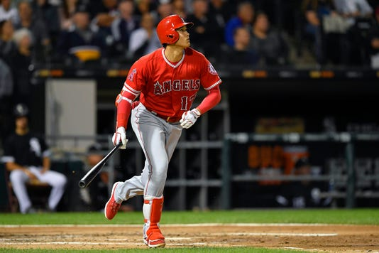 new product 5668b e75bb Shohei Ohtani makes more MLB history, weighs having Tommy ...