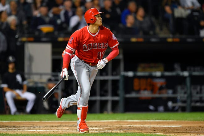 Los Angeles Angels designated hitter Shohei Ohtani (17) watches his three-run home run ball leave the park in the third inning against the Chicago White Sox at Guaranteed Rate Field.