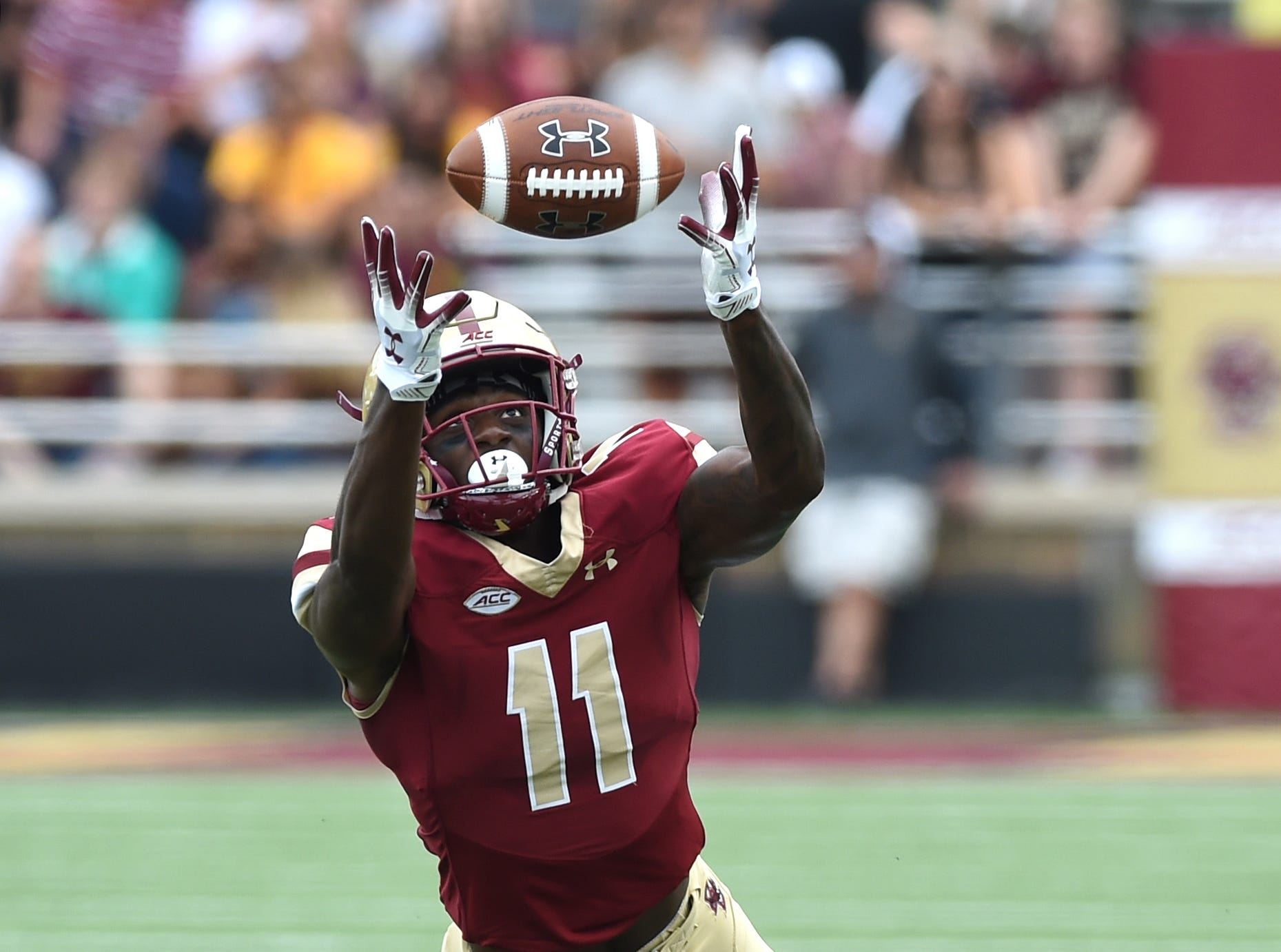 Boston College Eagles wide receiver CJ Lewis (11) reaches for the ball during the first half against the Holy Cross Crusaders at Alumni Stadium.