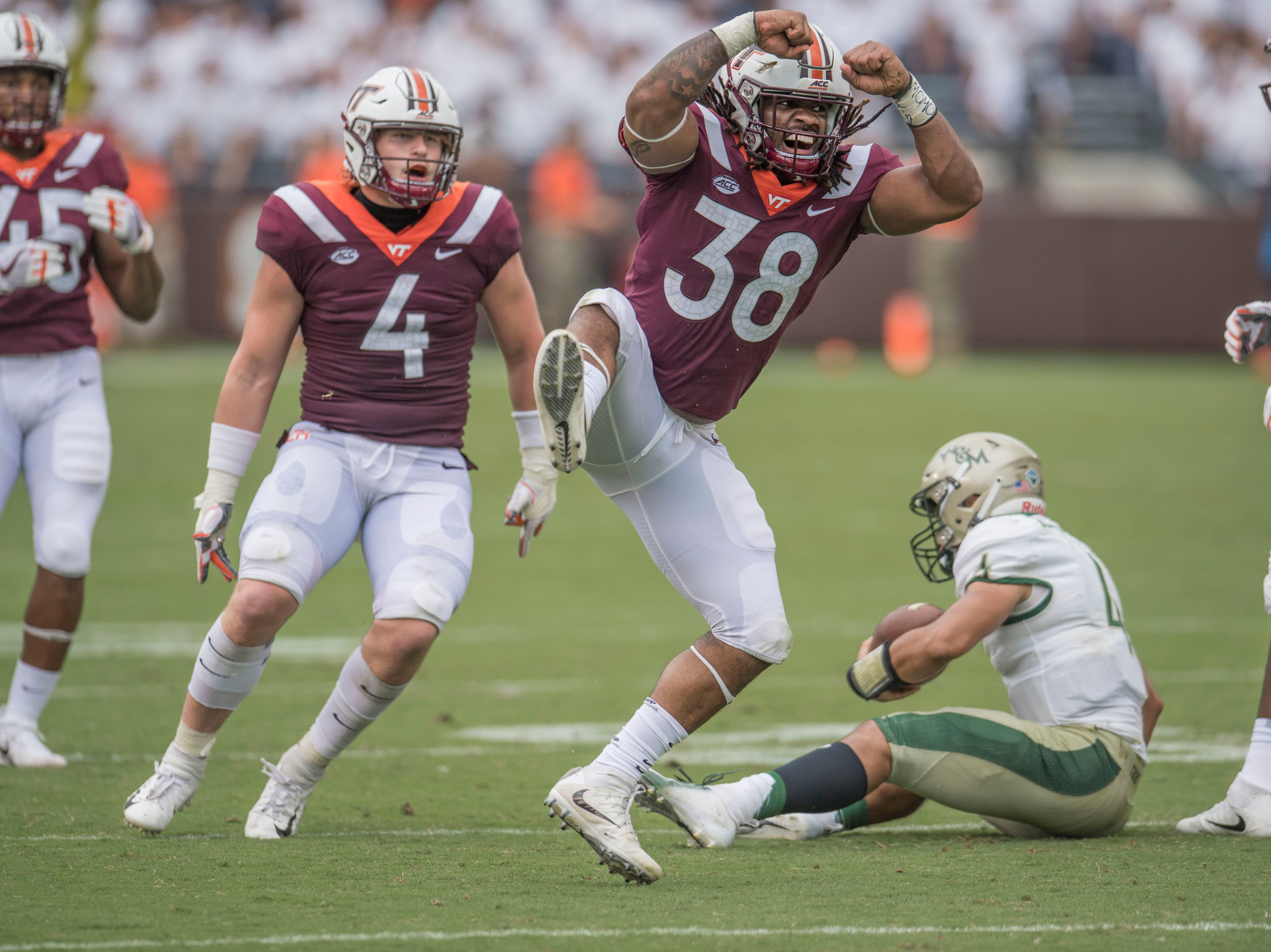 Virginia Tech Hokies linebacker Rico Kearney (38) celebrates after a sack of William & Mary quarterback Shon Mitchell in the second half at Lane Stadium.