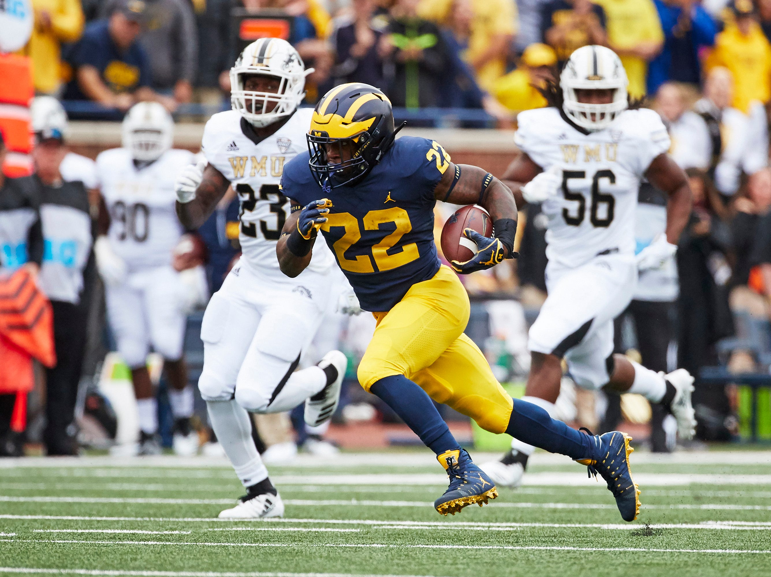Michigan running back Karan Higdon rushes in the first half against Western Michigan.