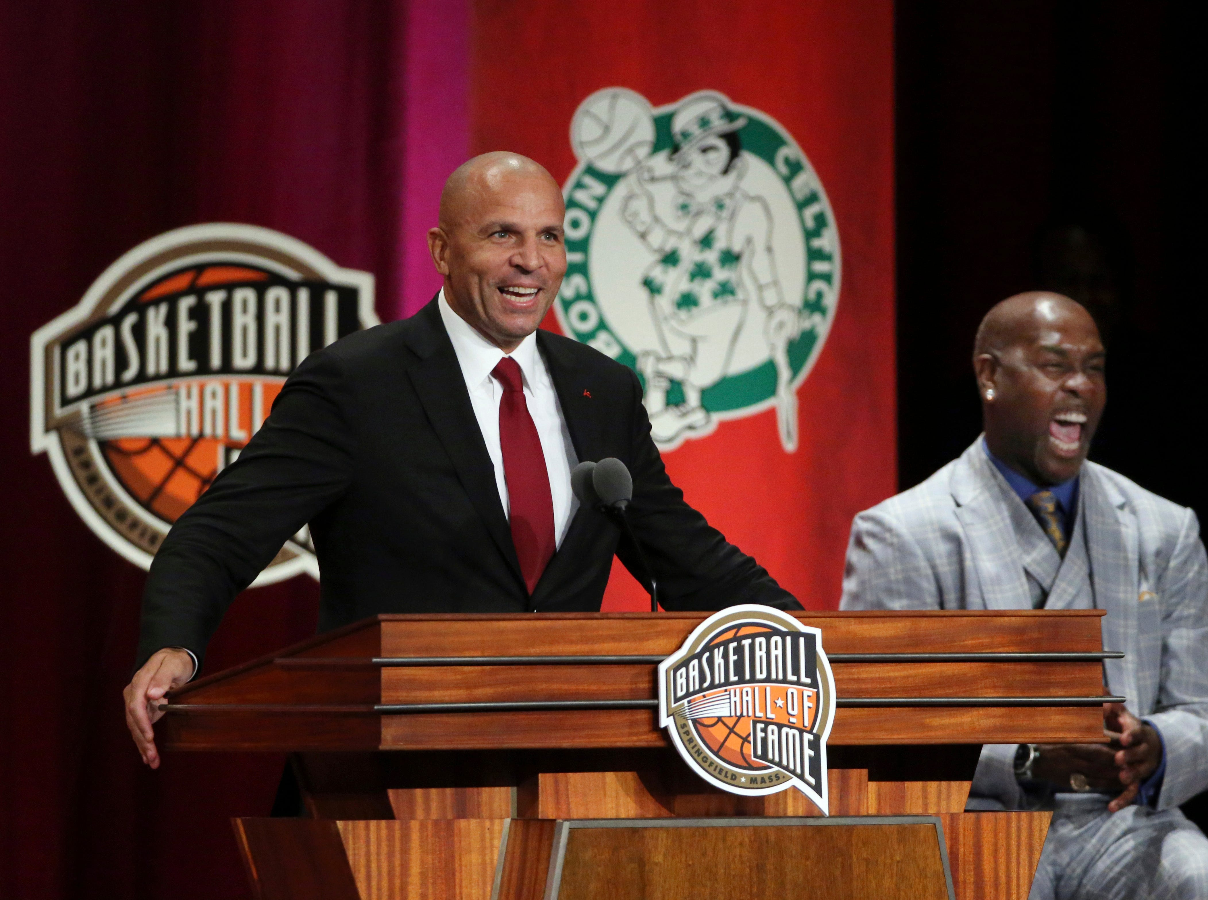 Jason Kidd, left, speaks as presenter Gary Payton, right, laughs during induction ceremonies into the Basketball Hall of Fame.