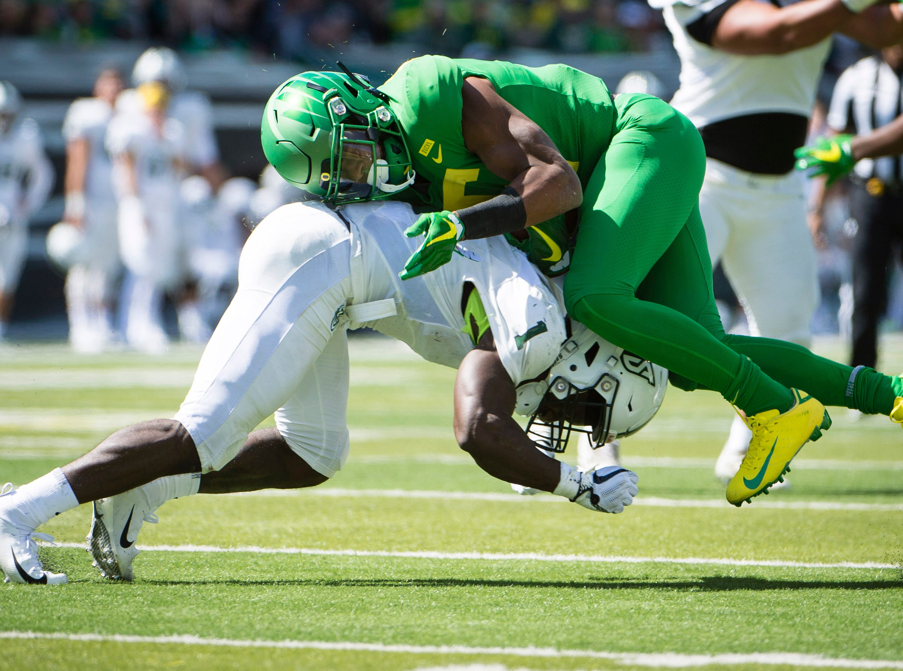 Portland State Vikings safety Romeo Gunt (1) tackles Oregon Ducks running back Taj Griffin (5) during the second half at Autzen Stadium.