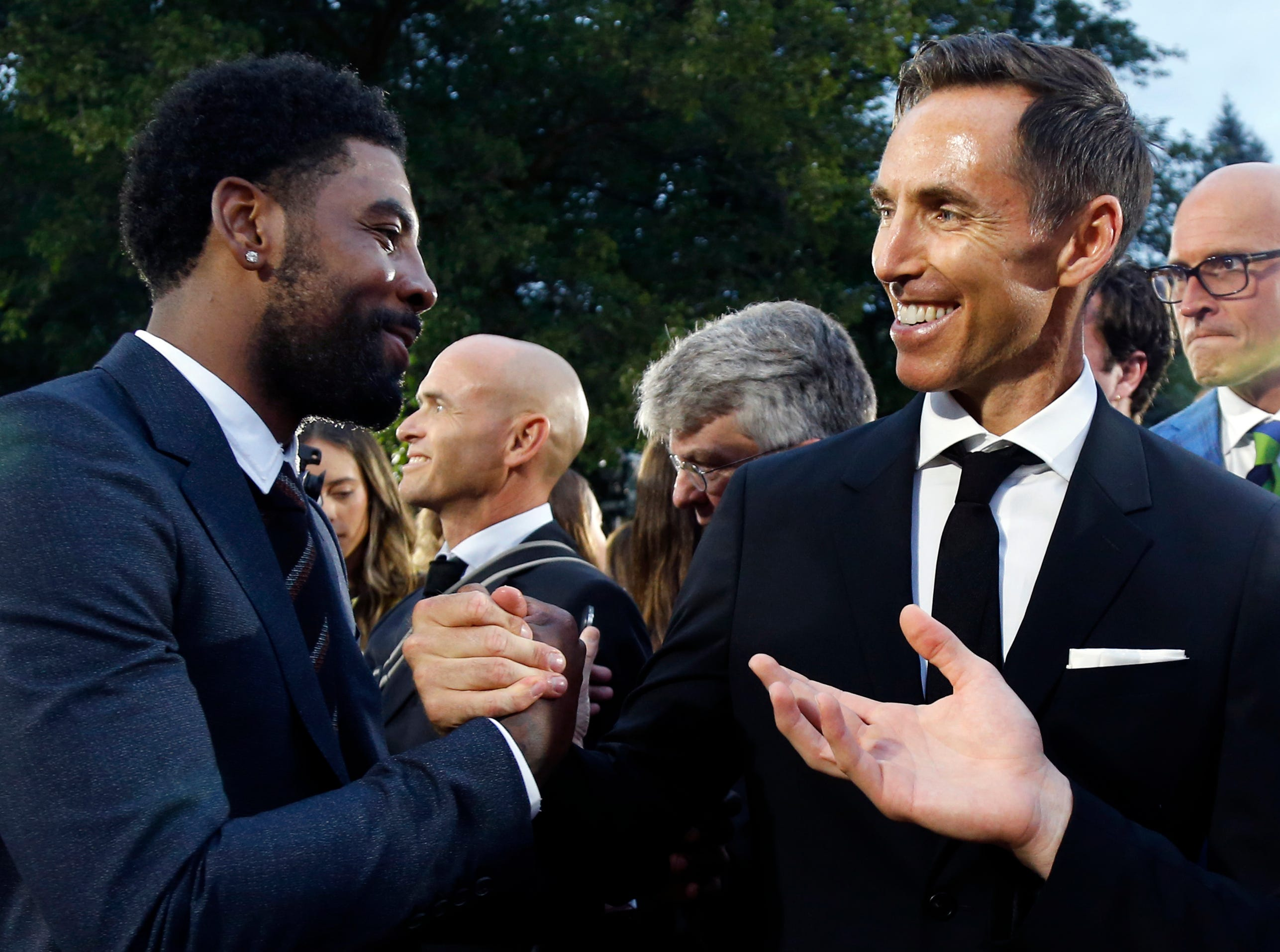 Steve Nash, right, greets Kyrie Irving on the red carpet before the induction ceremonies into the Basketball Hall of Fame.