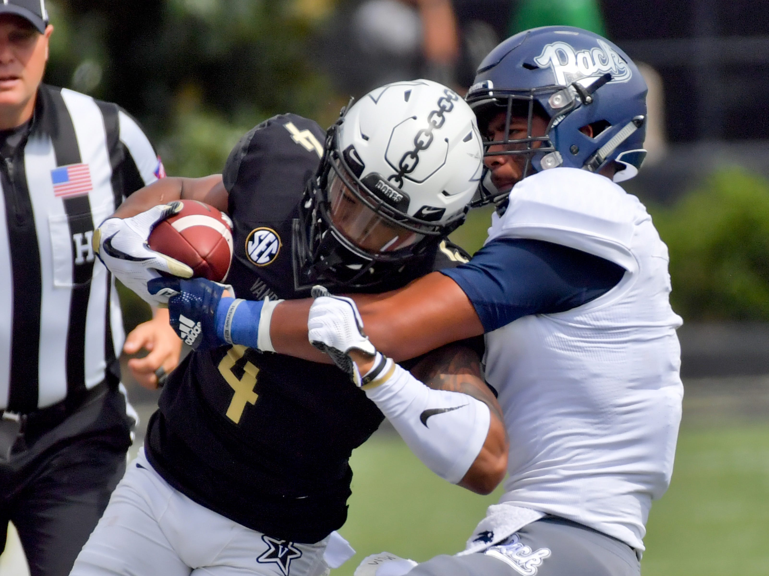 Vanderbilt wide receiver Donaven Tennyson tries to extend a play against Nevada.