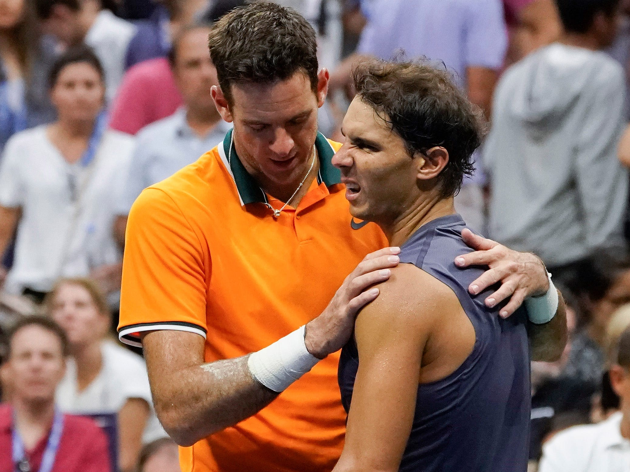 Rafael Nadal, right, greets Juan Martin del Potro after Nadal retired from the men's semifinal with a knee injury.