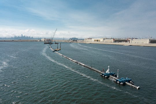The Ocean Cleanup System 001 floating in the lagoon in front of the assembly yard in Alameda, Calif.