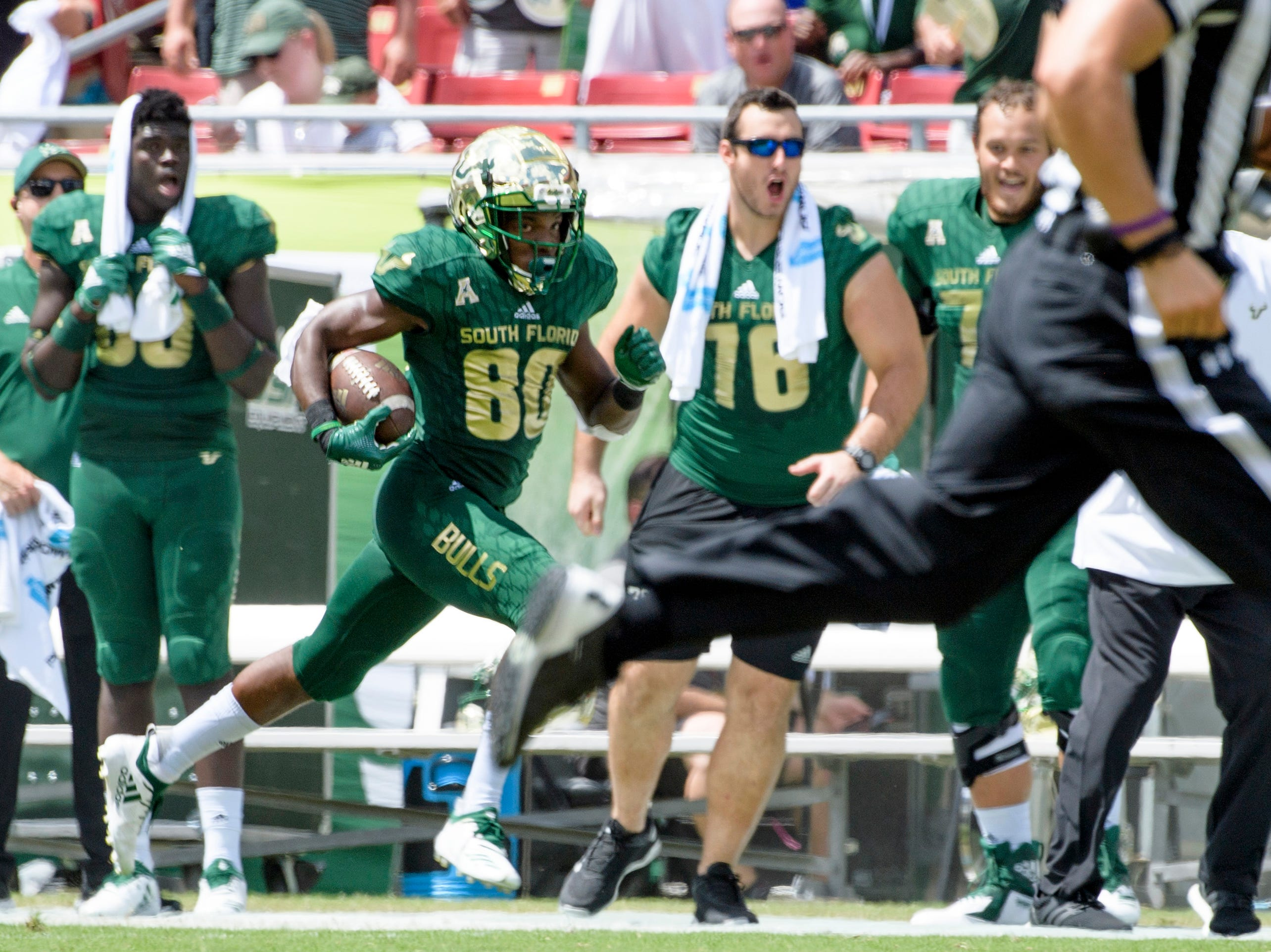 USF's Terrence Horne Jr. scores on a kick return in the first quarter against Georgia Tech.