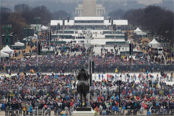 In this Jan. 20, 2017 file photo, crowds fill in the National Mall in Washington before the swearing in of Donald Trump as the 45th president of the Untied States during the Presidential Inauguration.