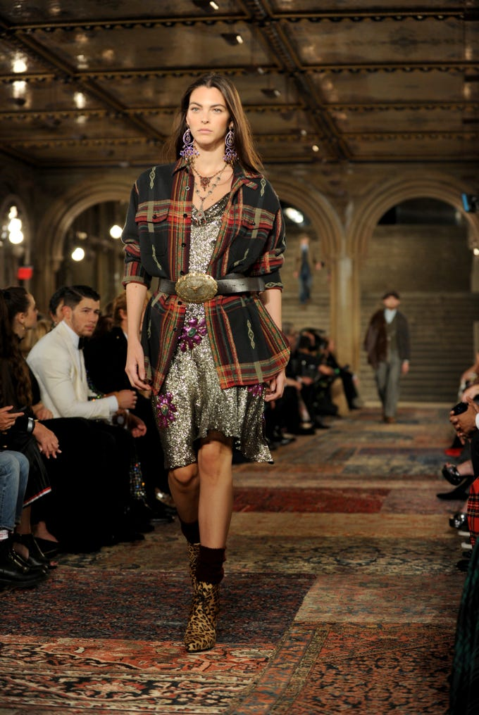 A model walks the runway at the Ralph Lauren 50th Anniversary Fashion Show during New York Fashion Week, Friday, Sept. 7, 2018. (AP Photo/Diane Bondareff) ORG XMIT: NYDB106