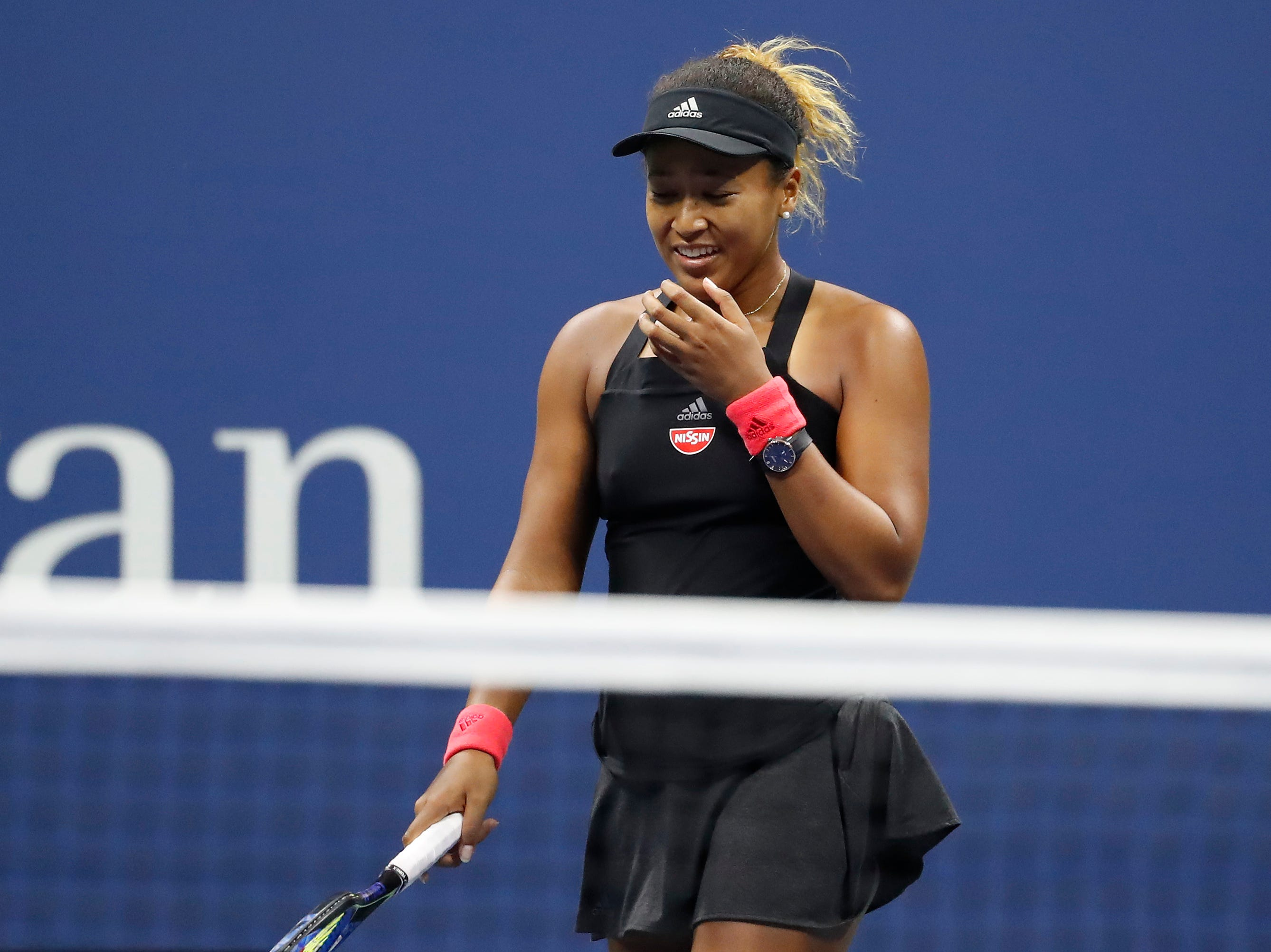 Naomi Osaka reacts after winning match point against Serena Williams. It was her first US Open title.