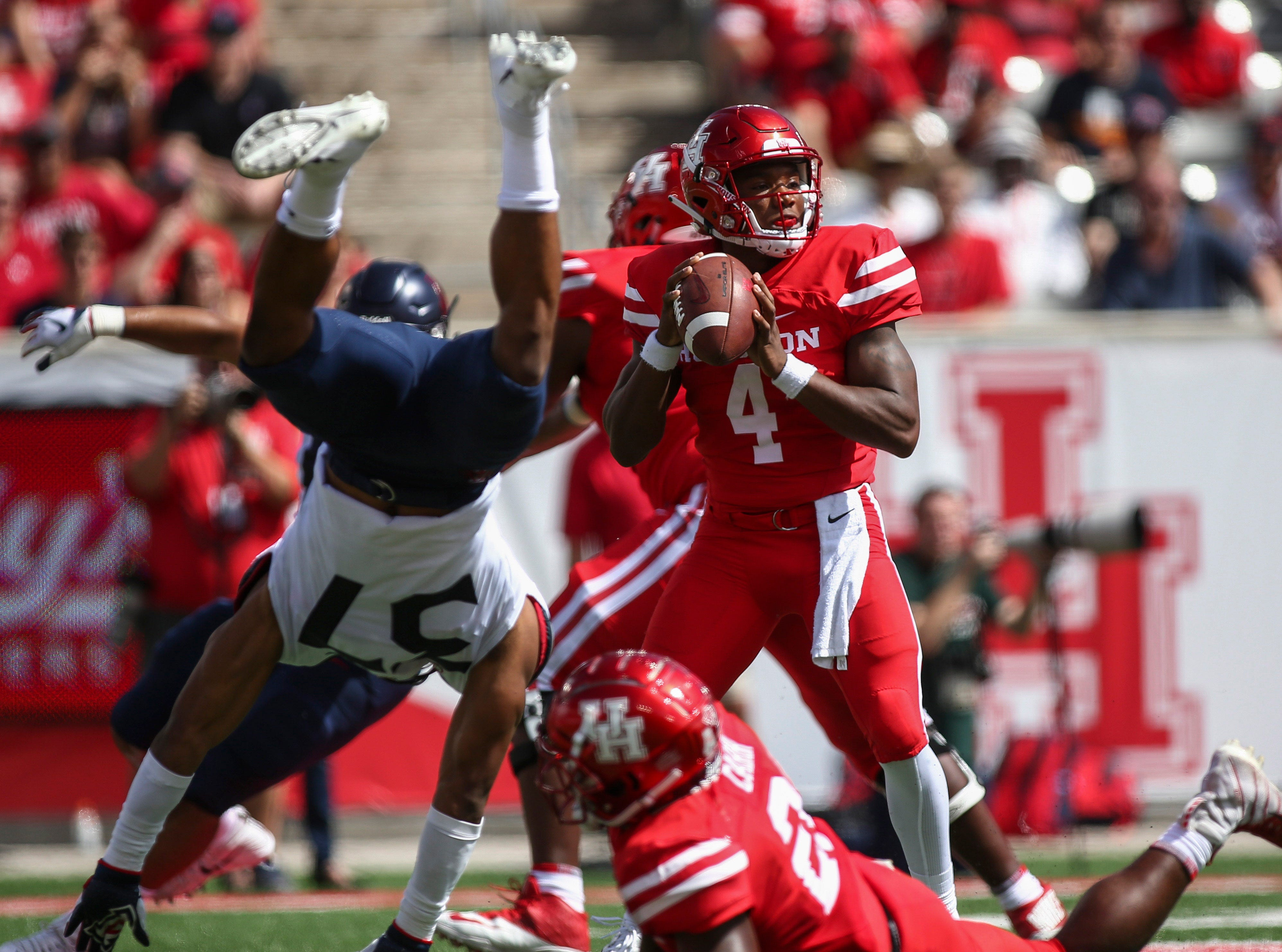 Arizona Wildcats safety Xavier Bell (37) flips as Houston Cougars quarterback D'Eriq King (4) attempts a pass during the first quarter at TDECU Stadium.