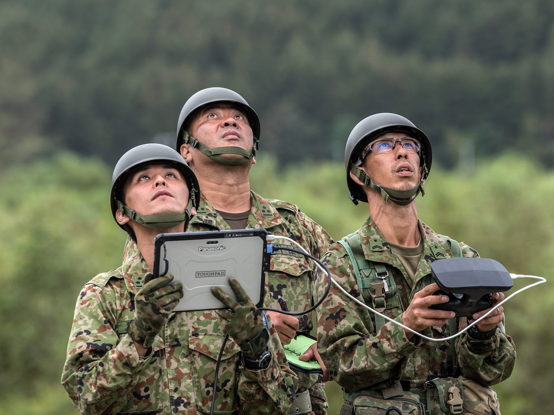 Soldiers operate a drone as they search for victims of a landslide triggered by an earthquake in Atsuma near Sapporo, Japan. Twenty one people are now confirmed to have been killed with eight still missing and hundreds injured.