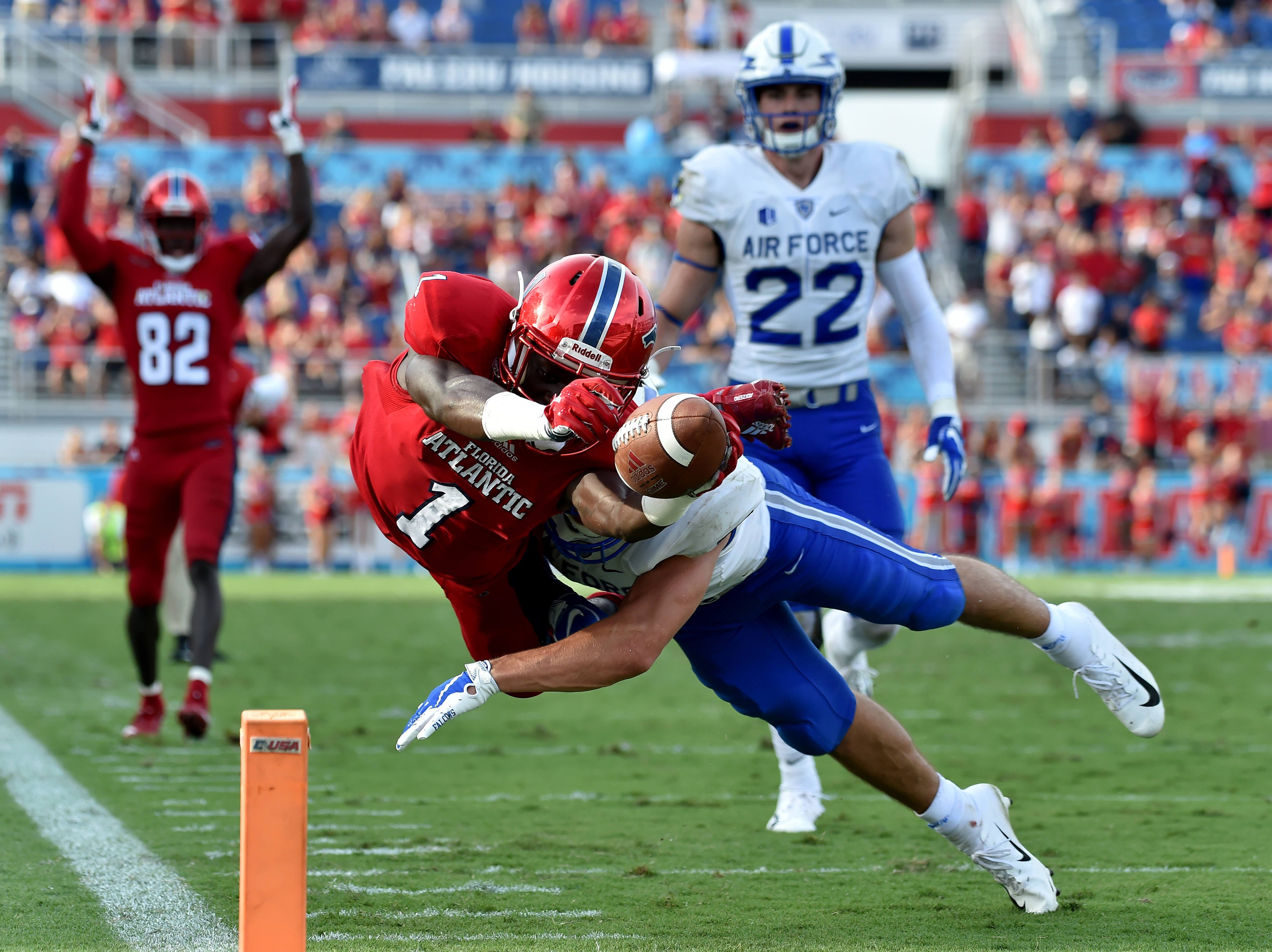 Florida Atlantic Owls wide receiver Willie Wright (1) dives over the pylon for a touchdown as Air Force Falcons defensive back Jeremy Fejedelem (2) defends the play during the second half at FAU Football Stadium.