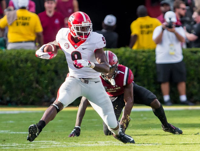 Georgia wide receiver Jeremiah Holloman breaks away from South Carolina defensive back Jaycee Horn during the second half.