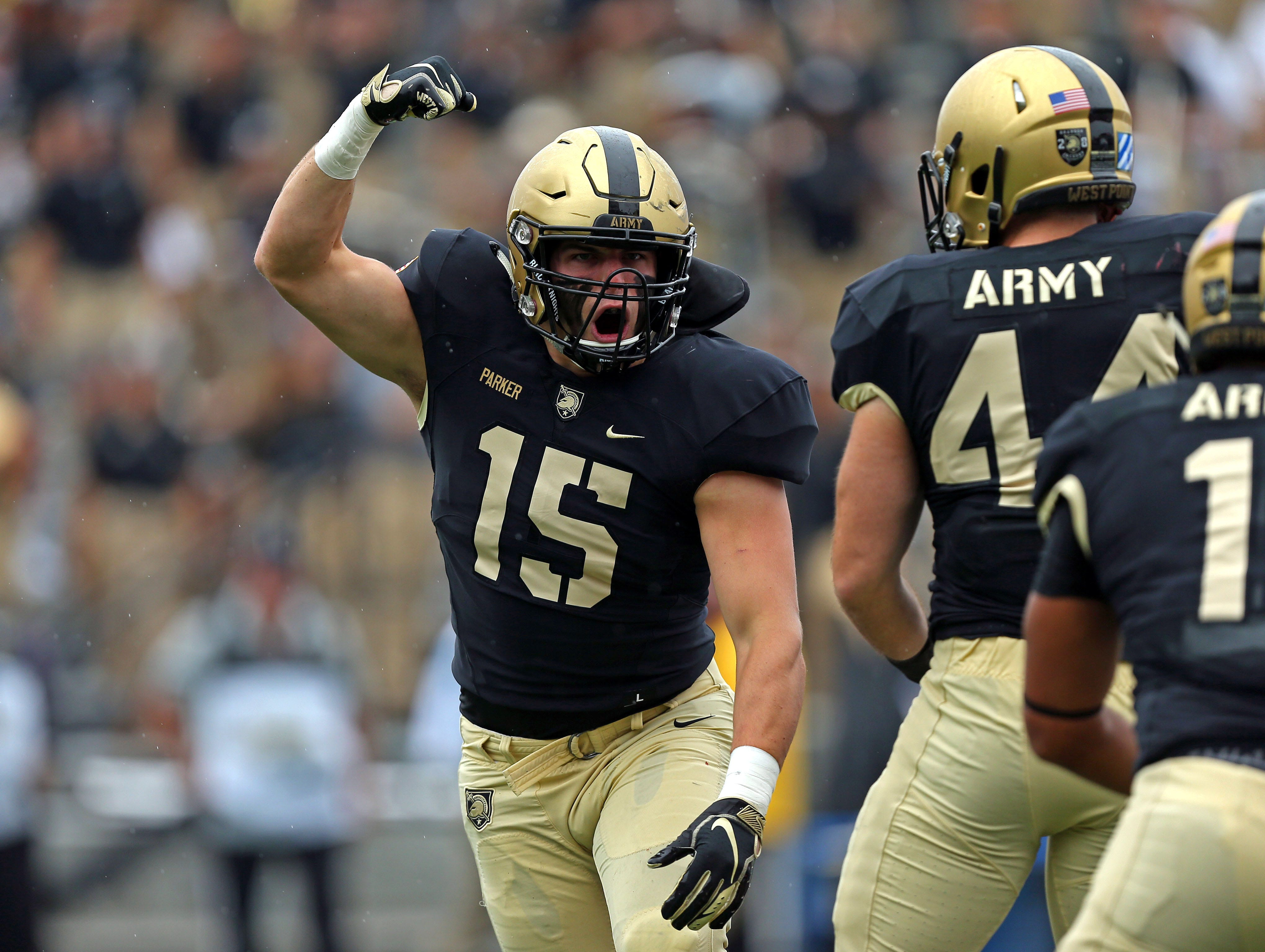 Army Black Knights linebacker Ryan Parker (15) reacts to a defensive stop against the Liberty Flames during the second half at Michie Stadium.